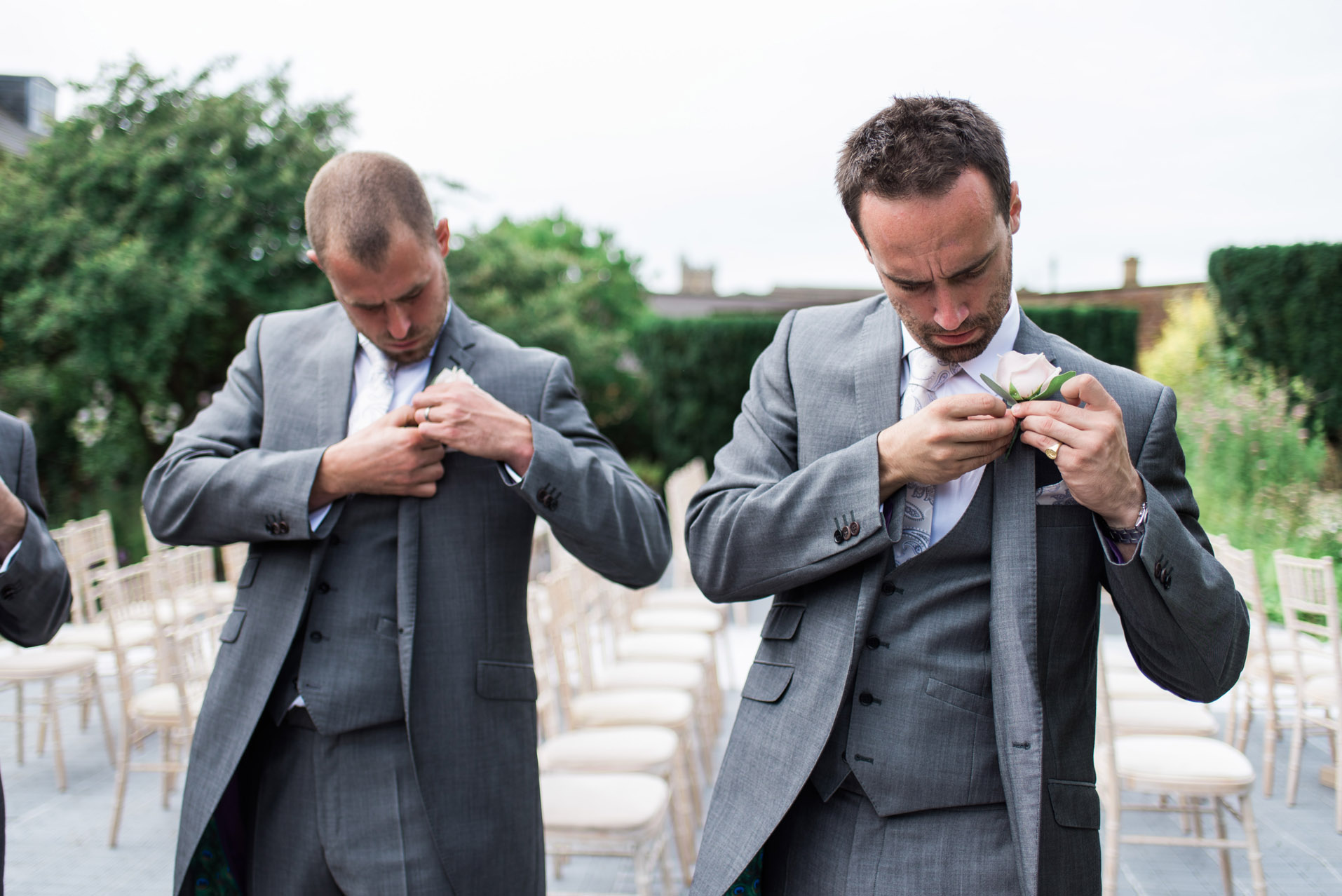 Groom puts on button hole