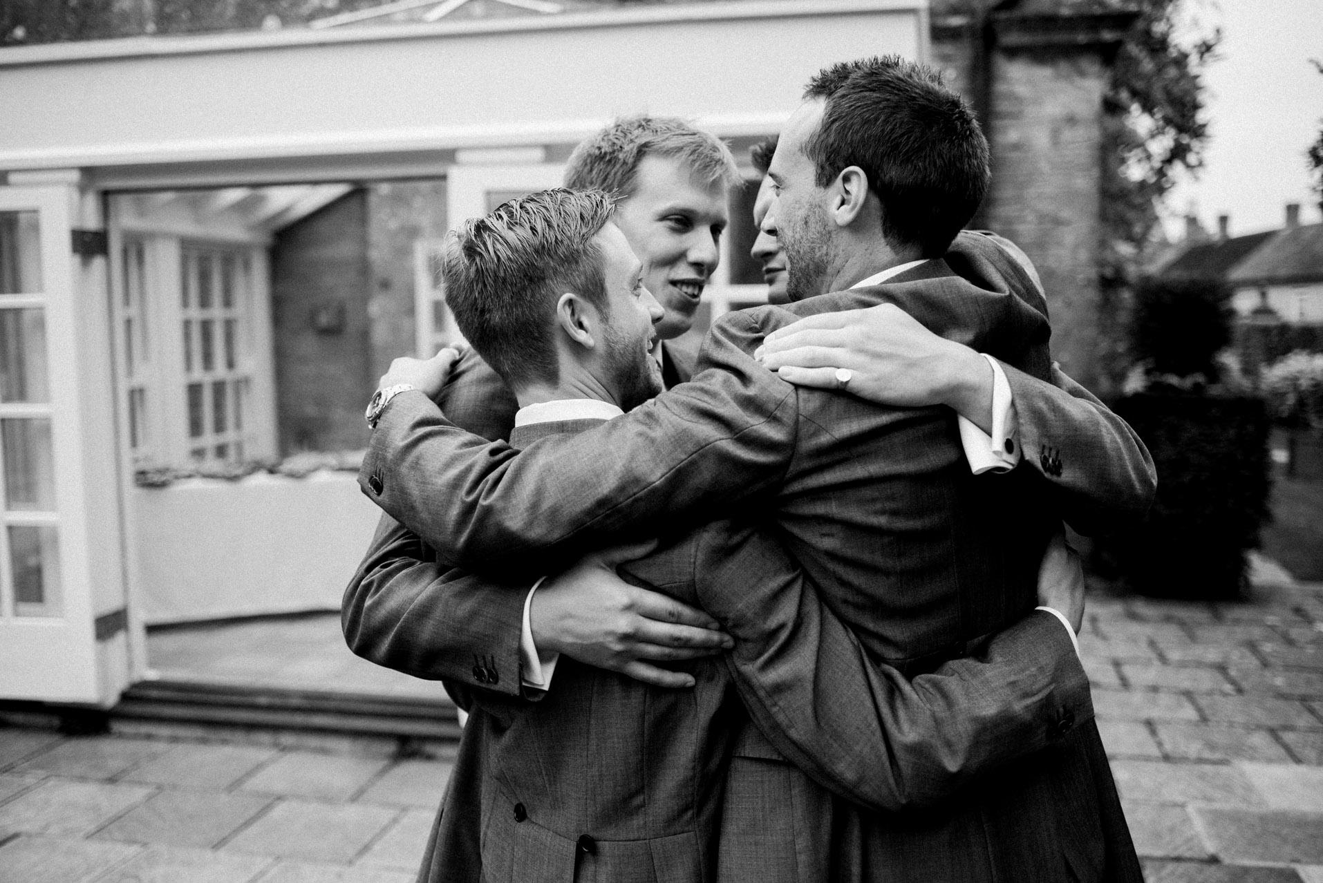 guys celebrating with hug
