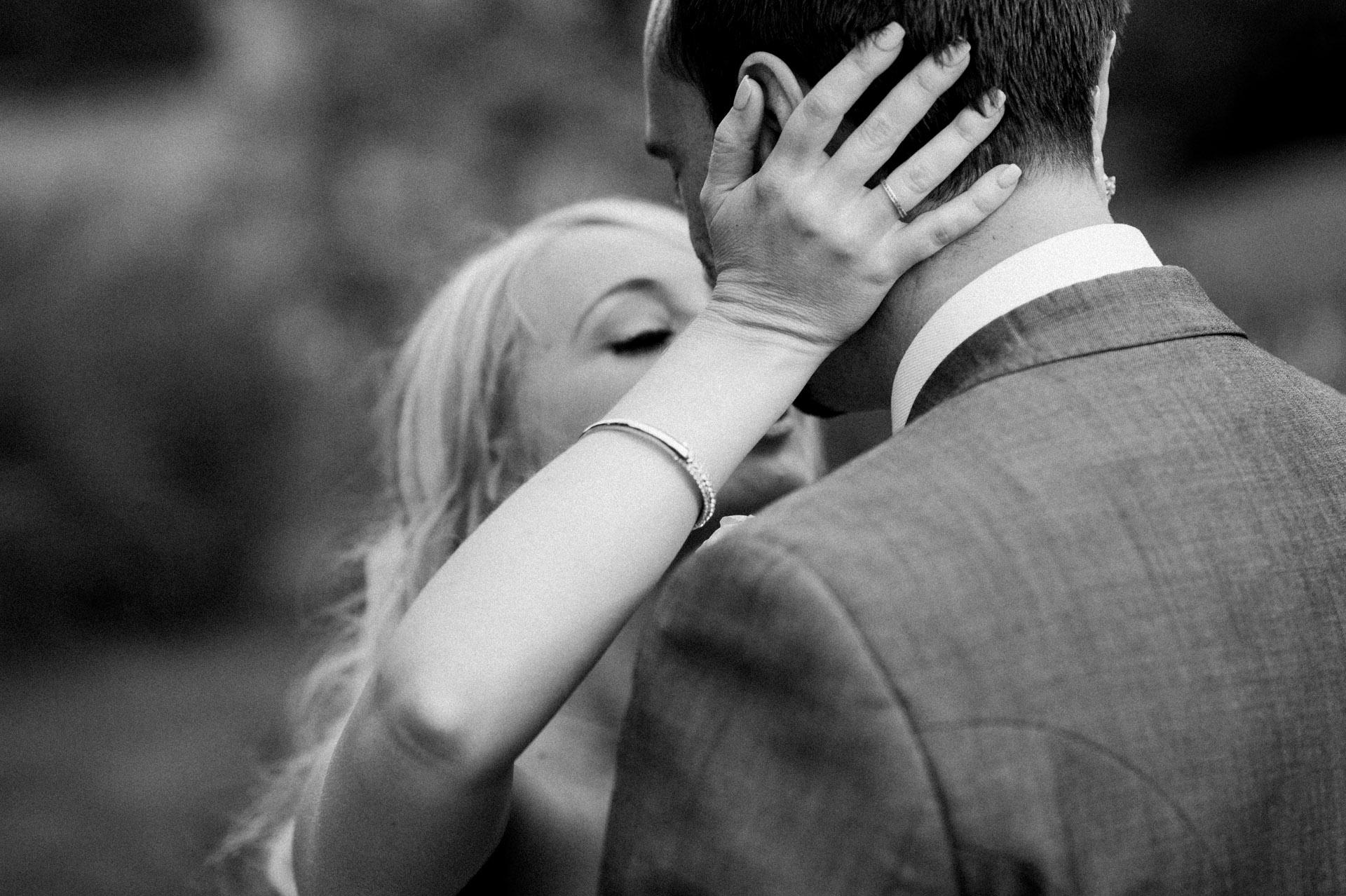 bride kisses groom Dillington House Wedding