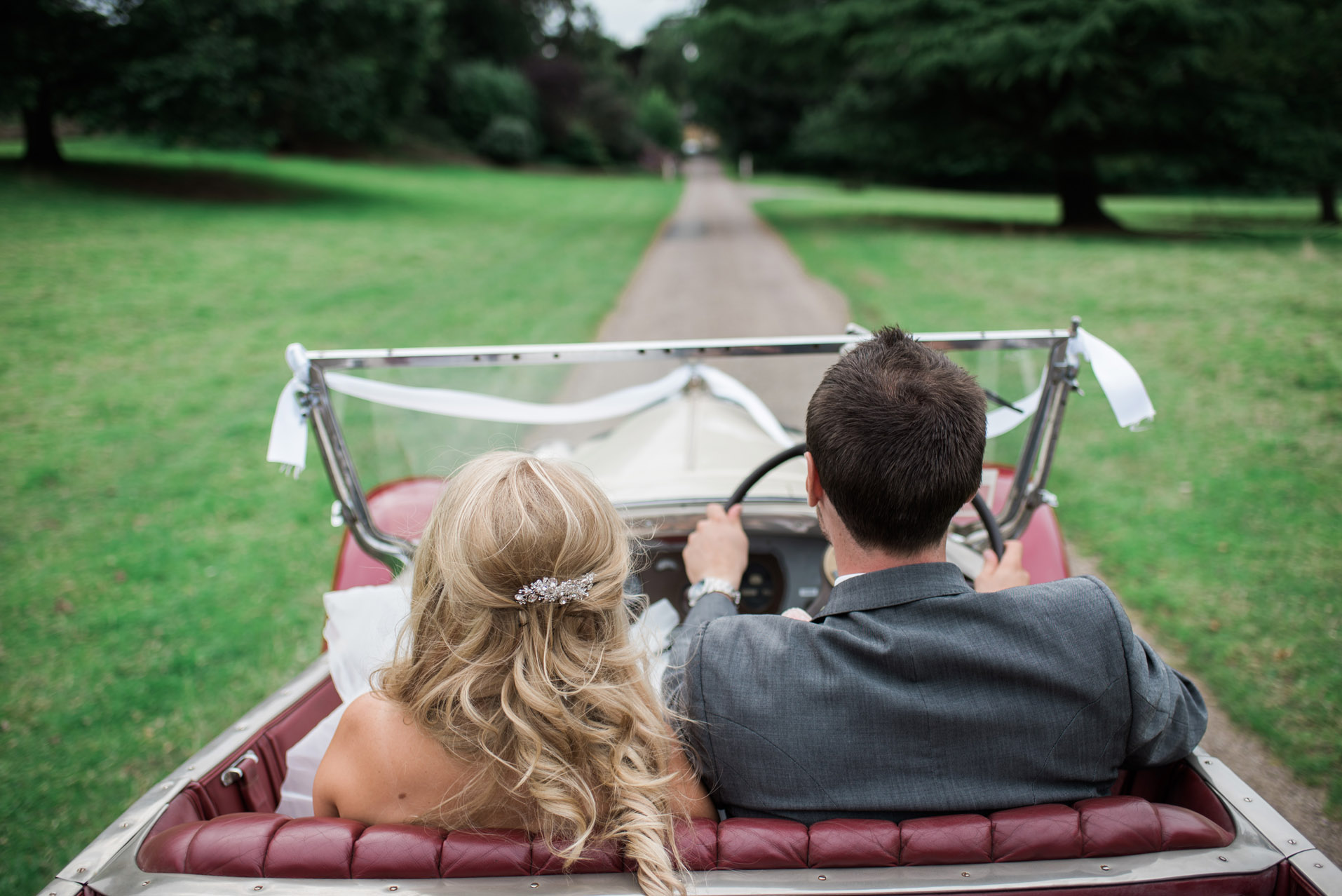 Bride and Groom driving at Dillington House