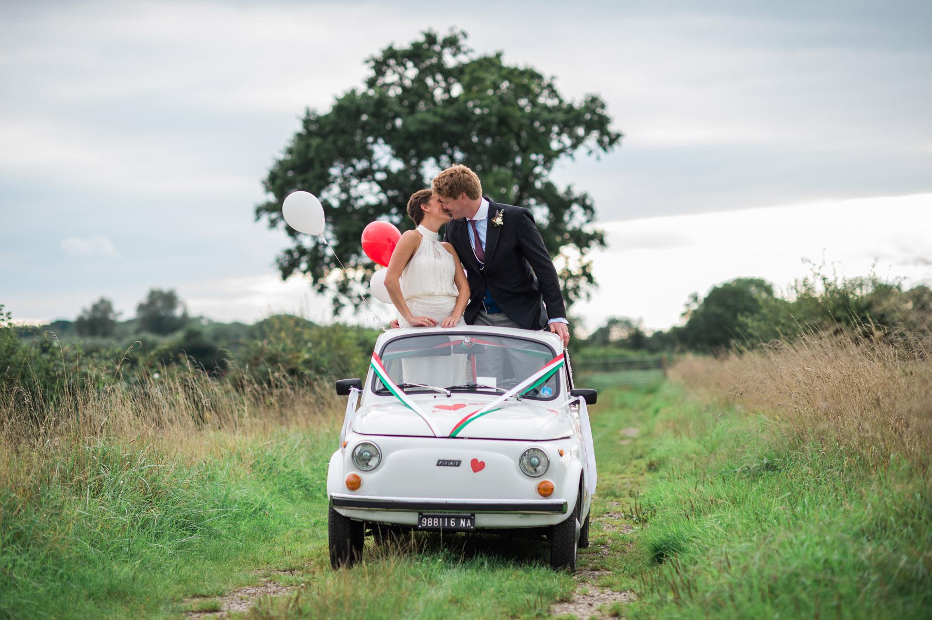 newlyweds in beetle car