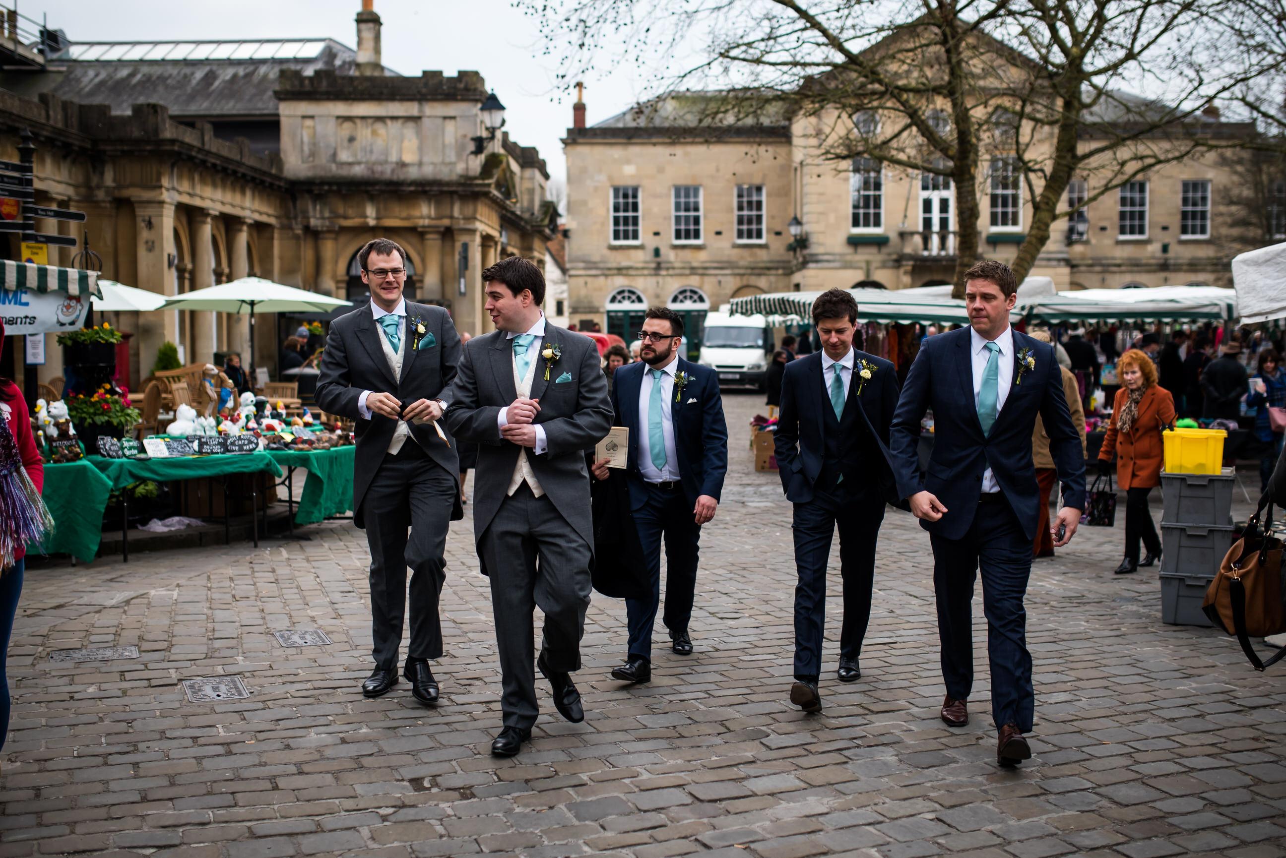 Groomsmen walk through Wells