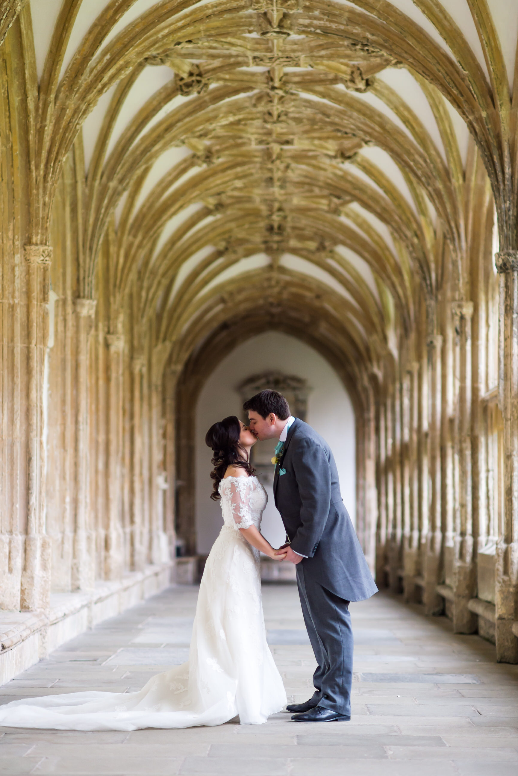 Bride and groom kiss Wells Cathedral
