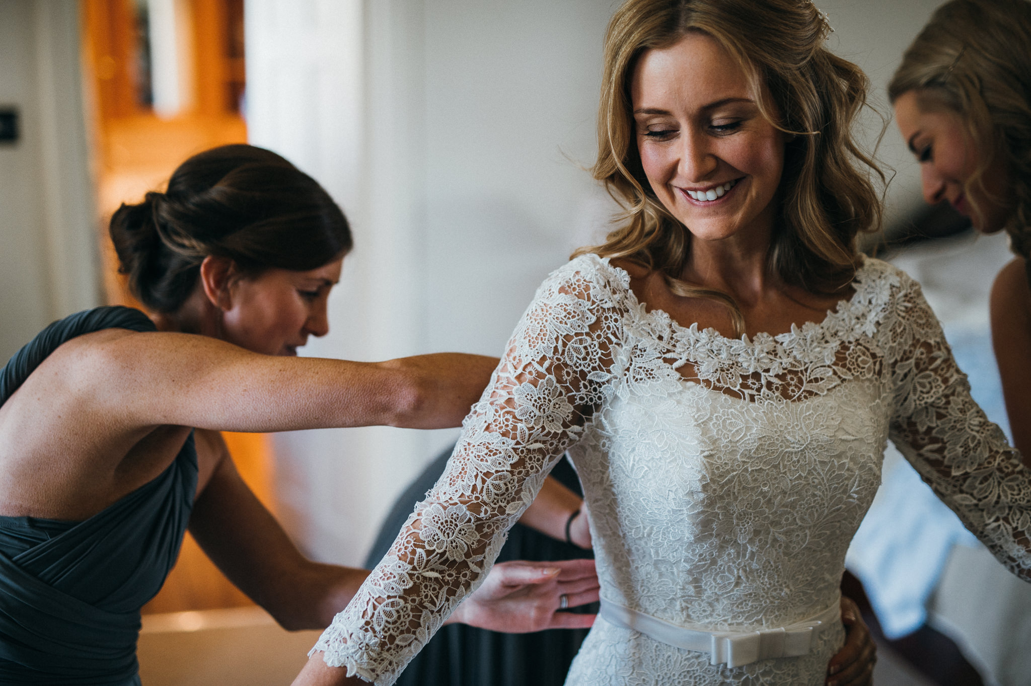 Bride excited to be putting wedding dress on