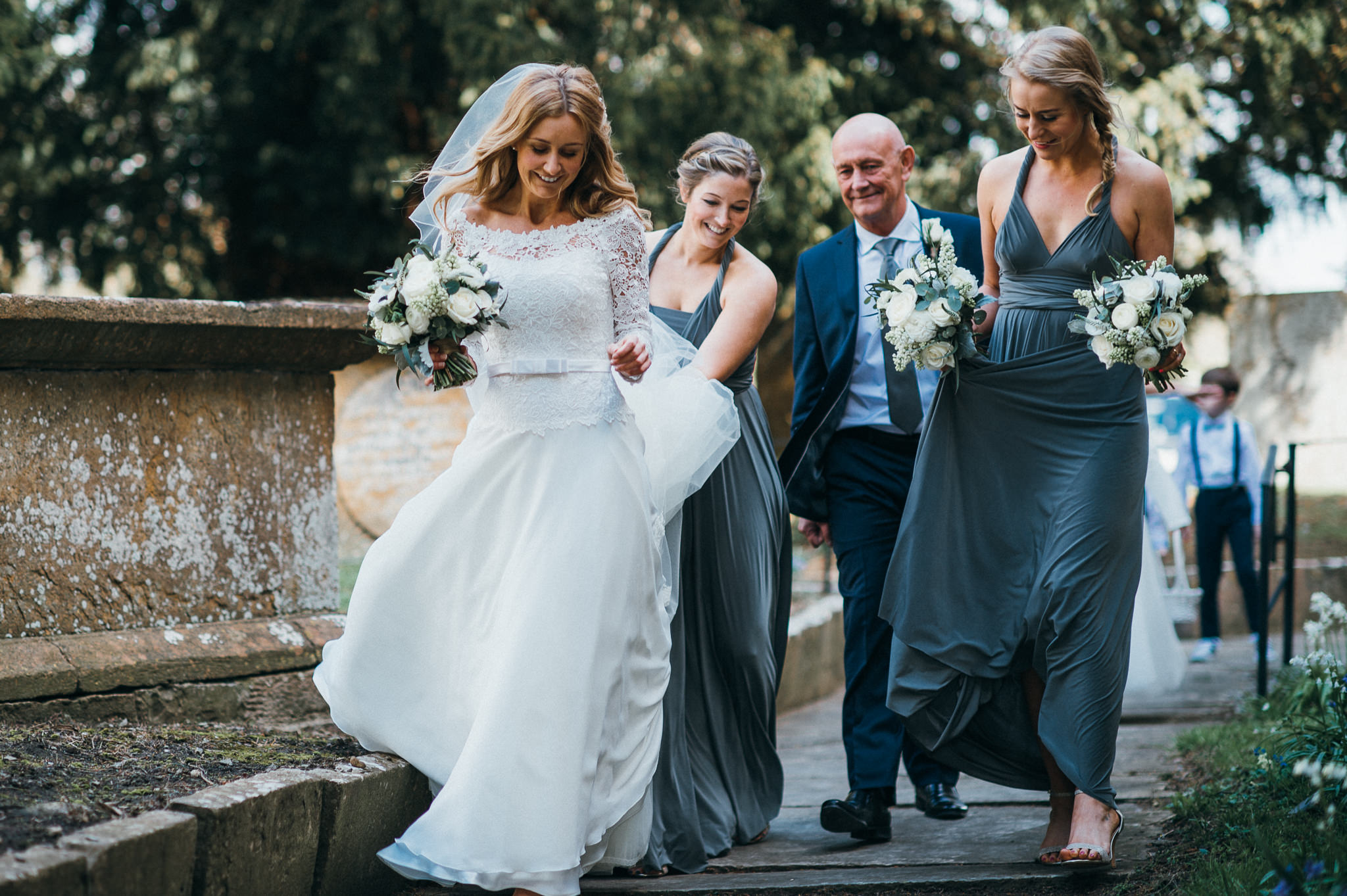 Bride walks into Church of St Peter and St Paul, Muchelney