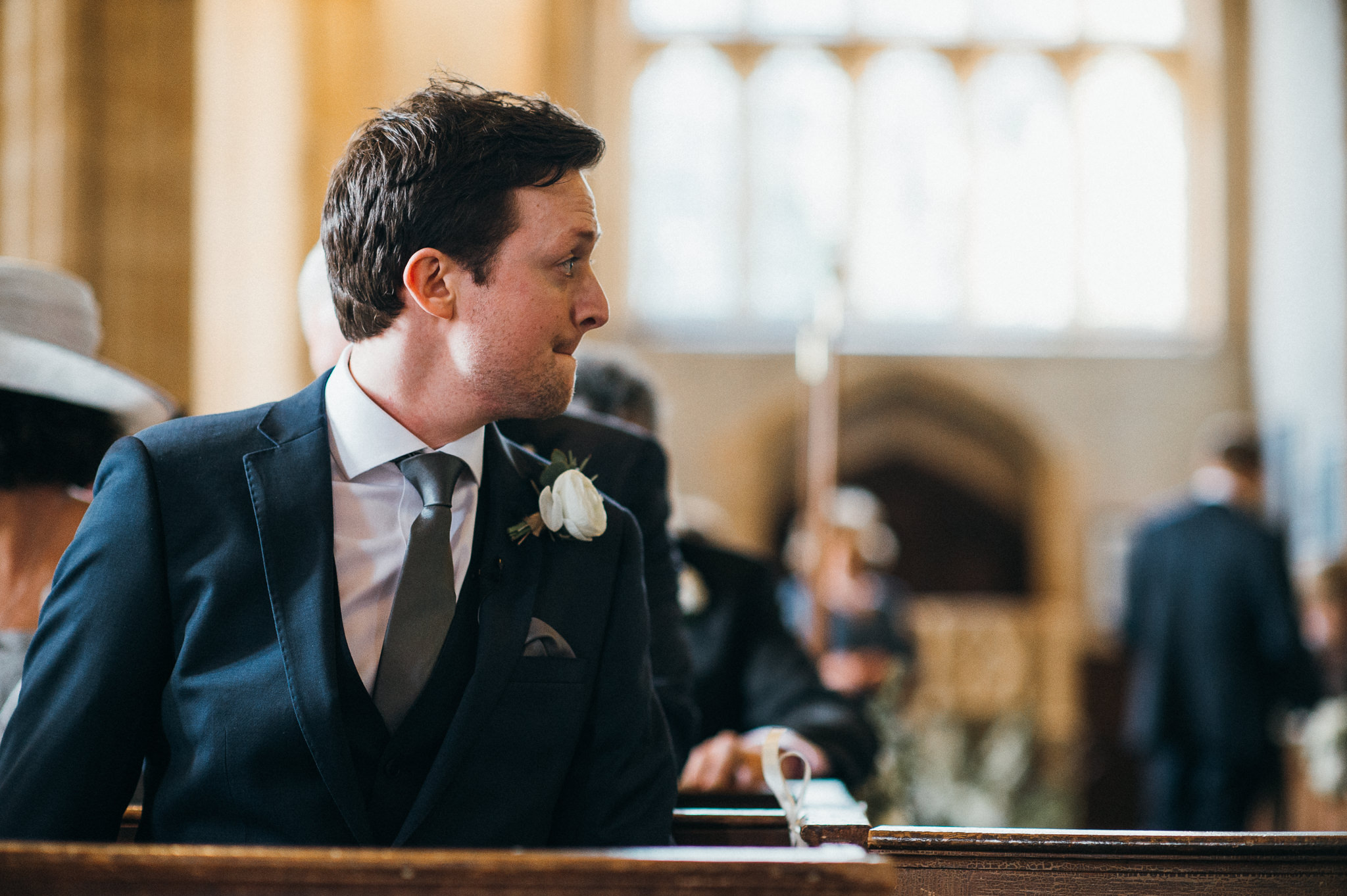 Groom looks back at Church of St Peter and St Paul, Muchelney