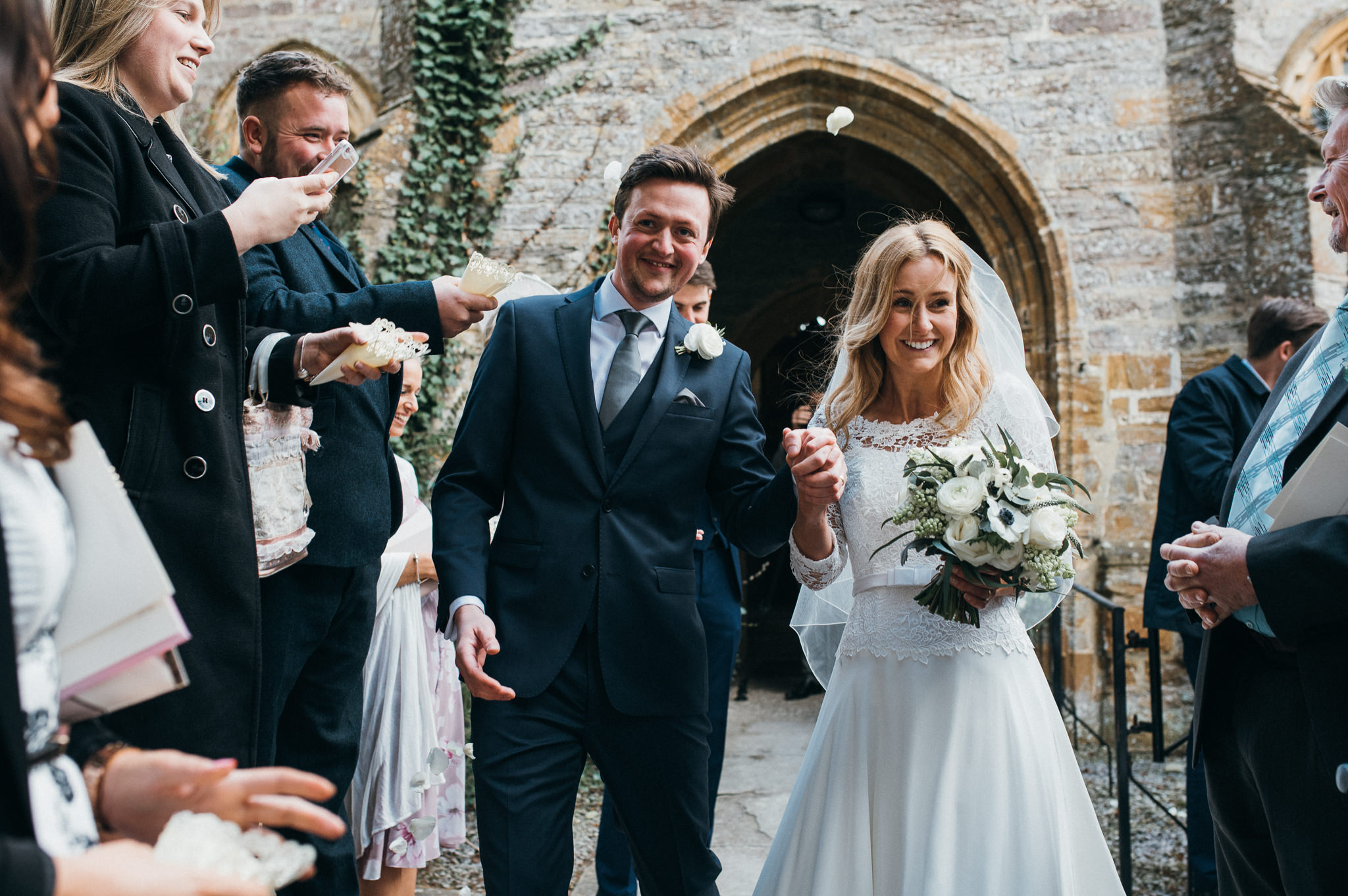 Bride and Groom confetti at Church of St Peter and St Paul, Muchelney