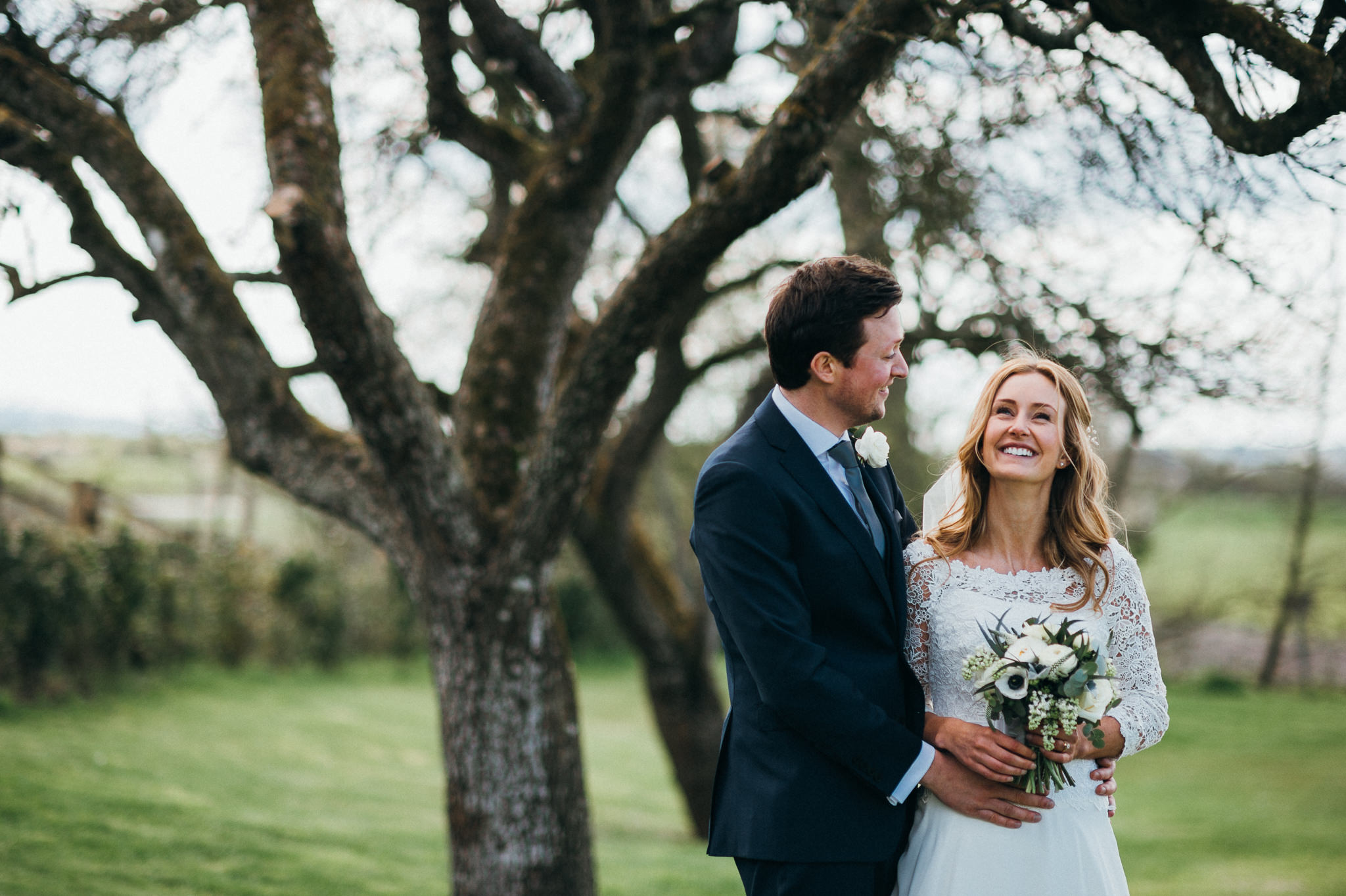 bride and groom laugh together at Almonry Barn, Somerset
