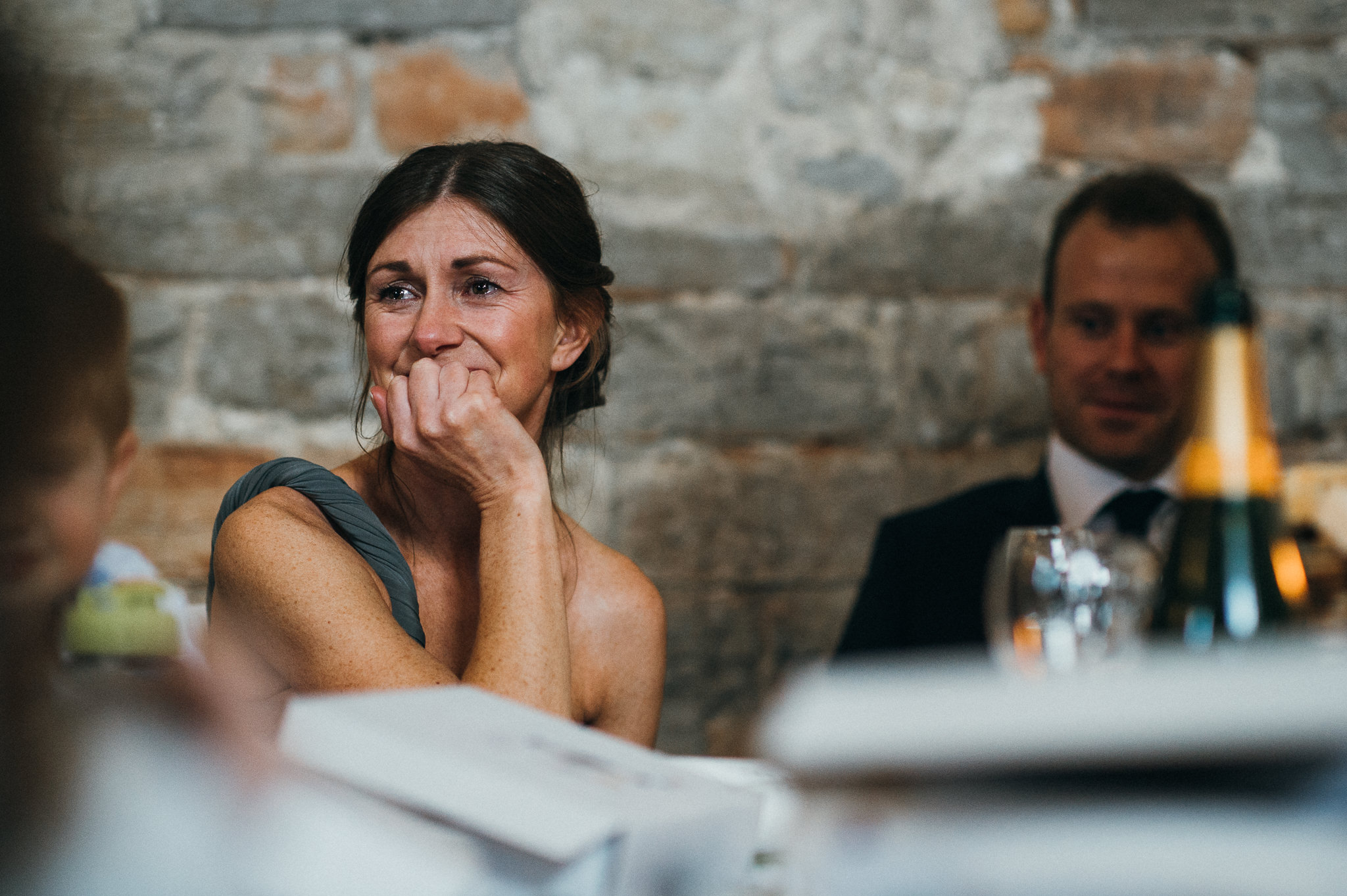 guest listen to wedding speech at almonry barn