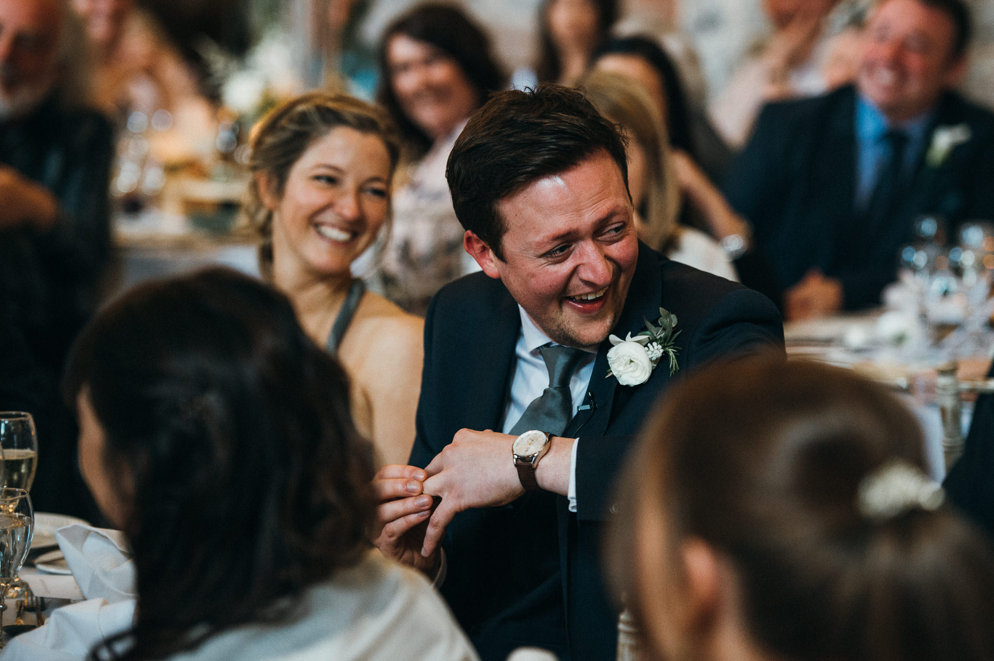 guests react to speech at wedding at the almonry barn