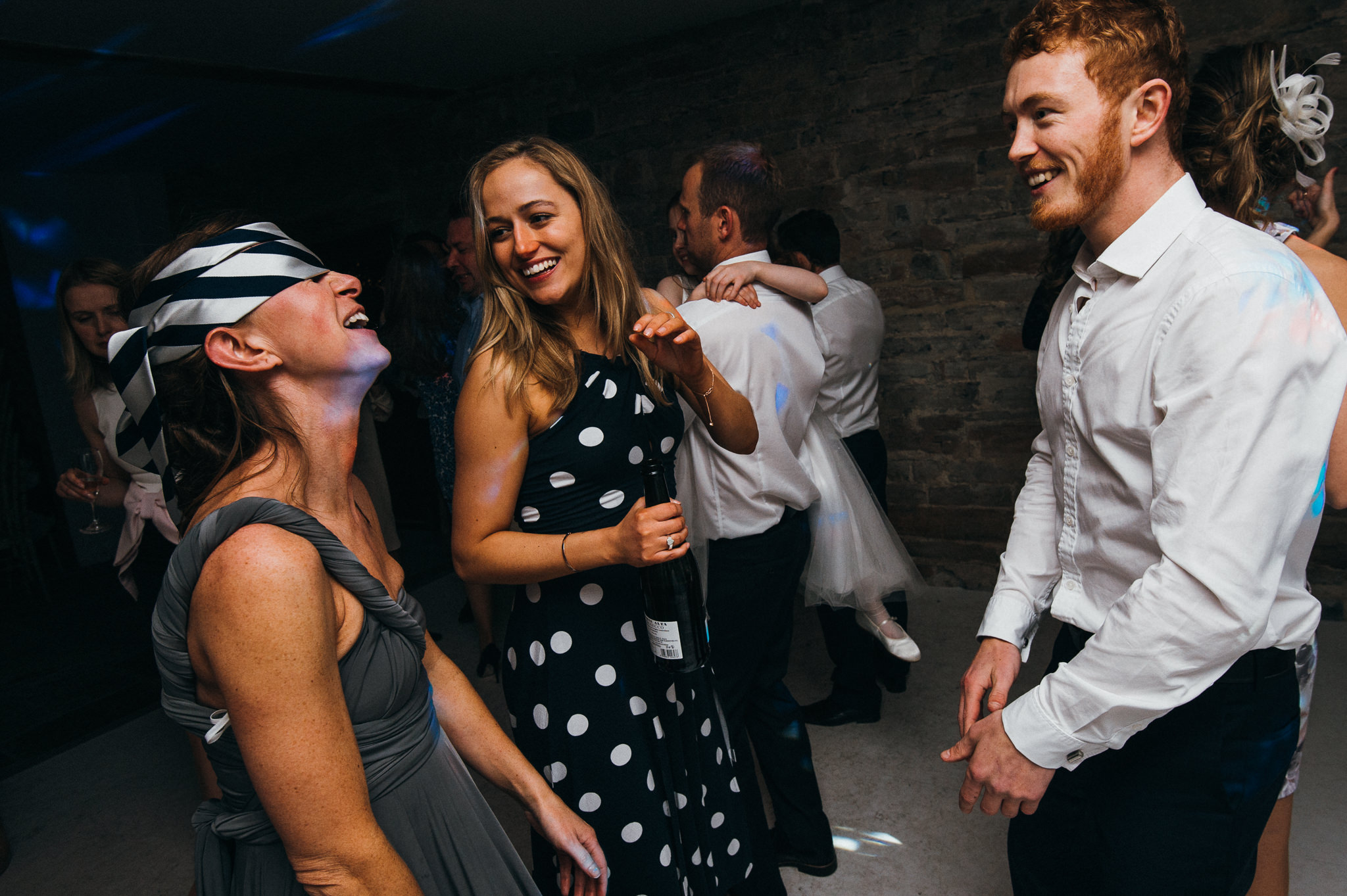 ties on heads on the dance floor, Almonry barn wedding