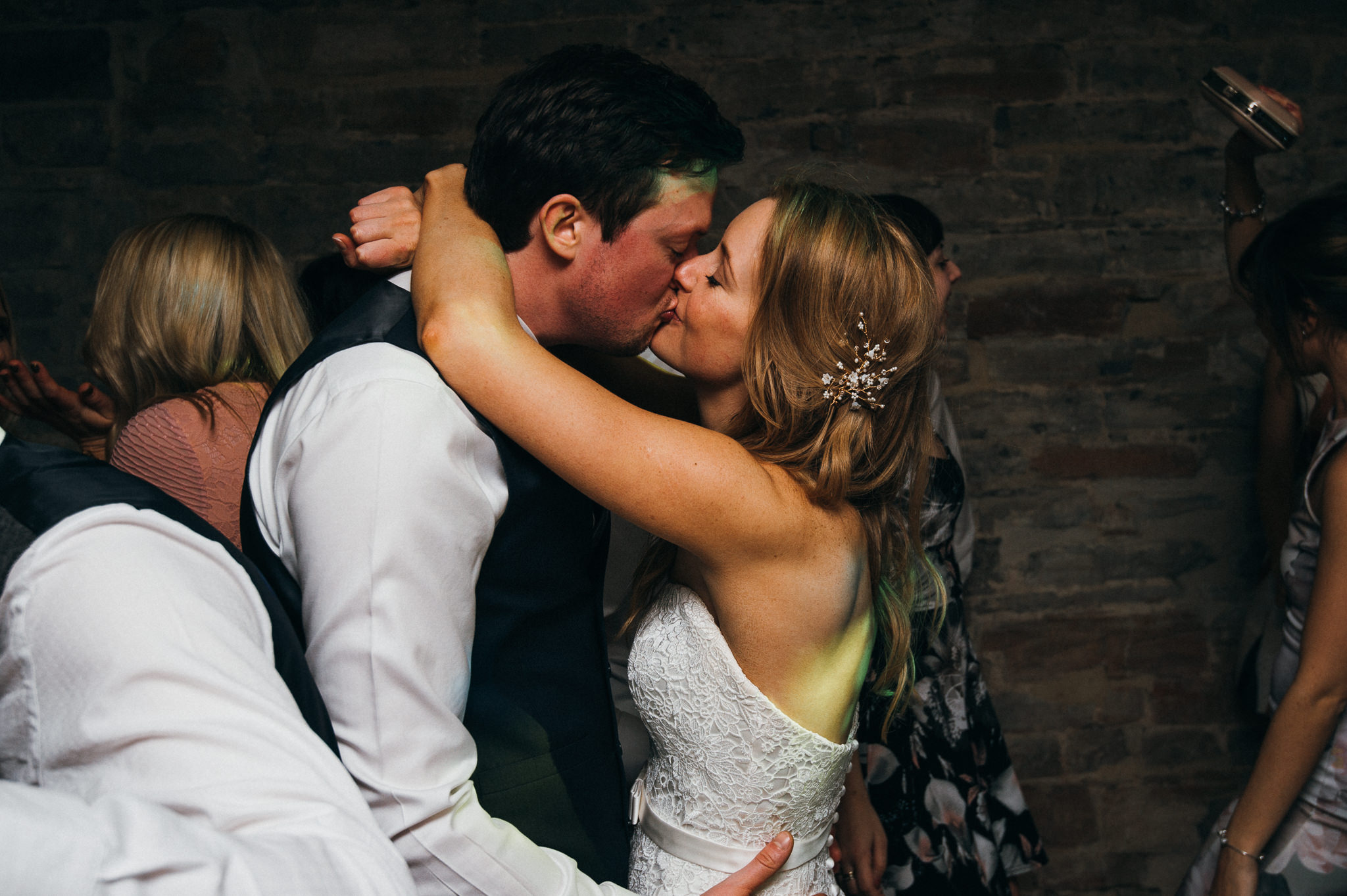 bride and groom kiss on dance floor Almonry barn