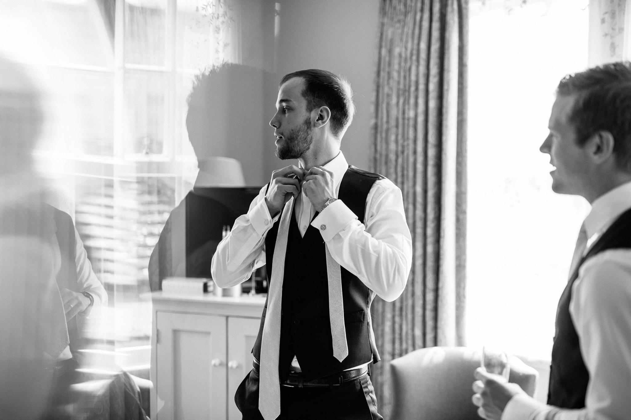 usher puts tie on