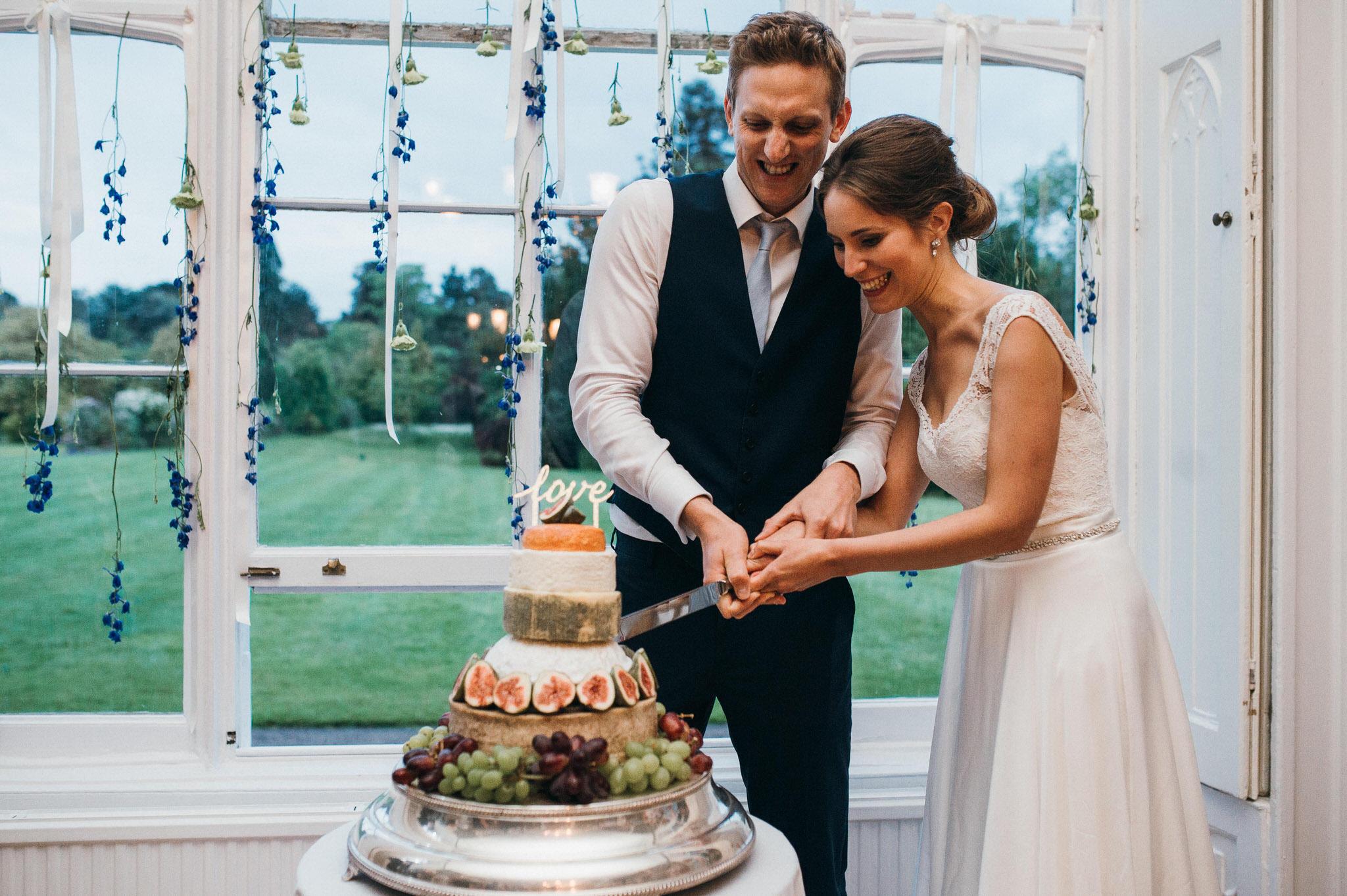 Cake cut Nonsuch Mansion wedding