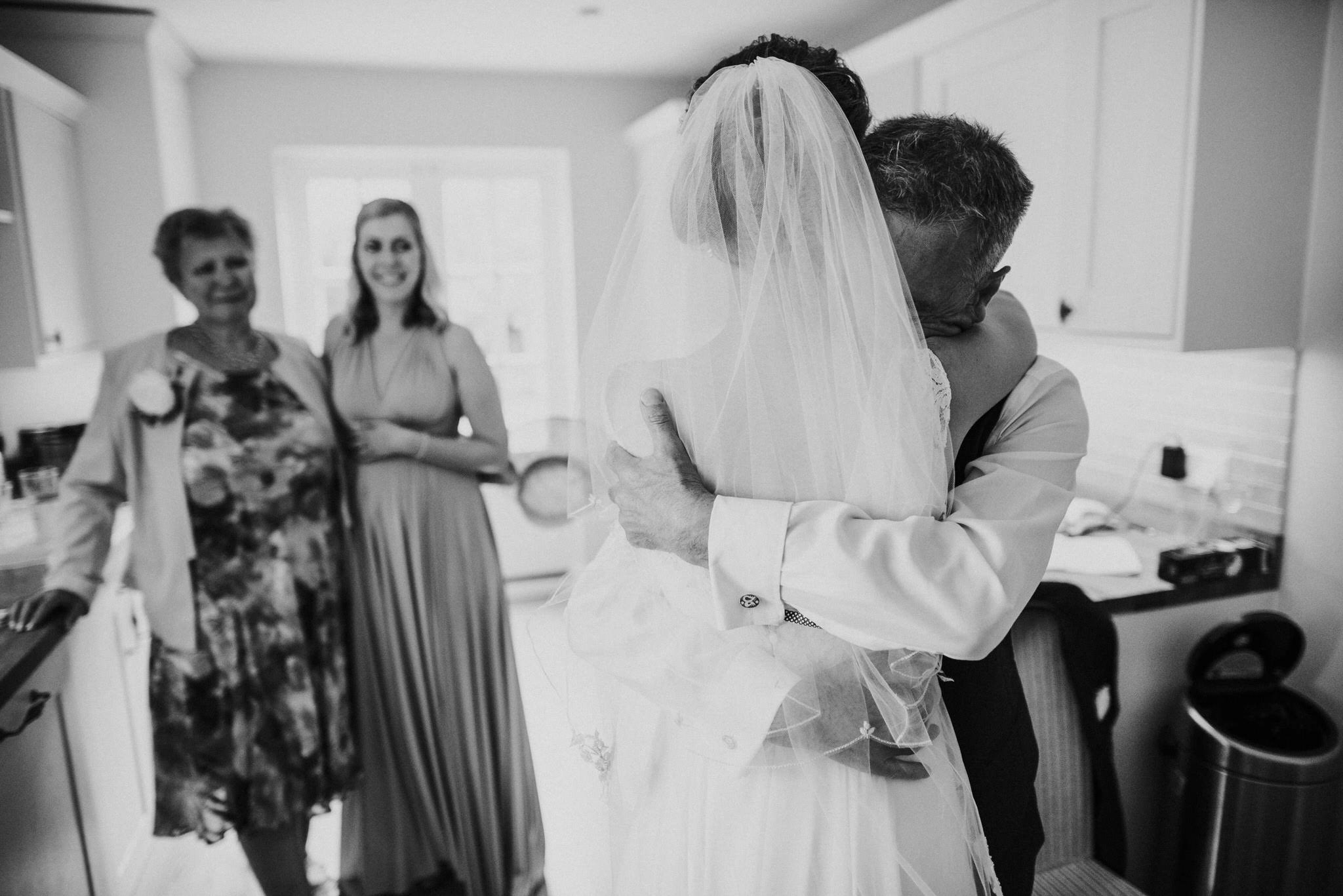 Dad hugs daughter on wedding day