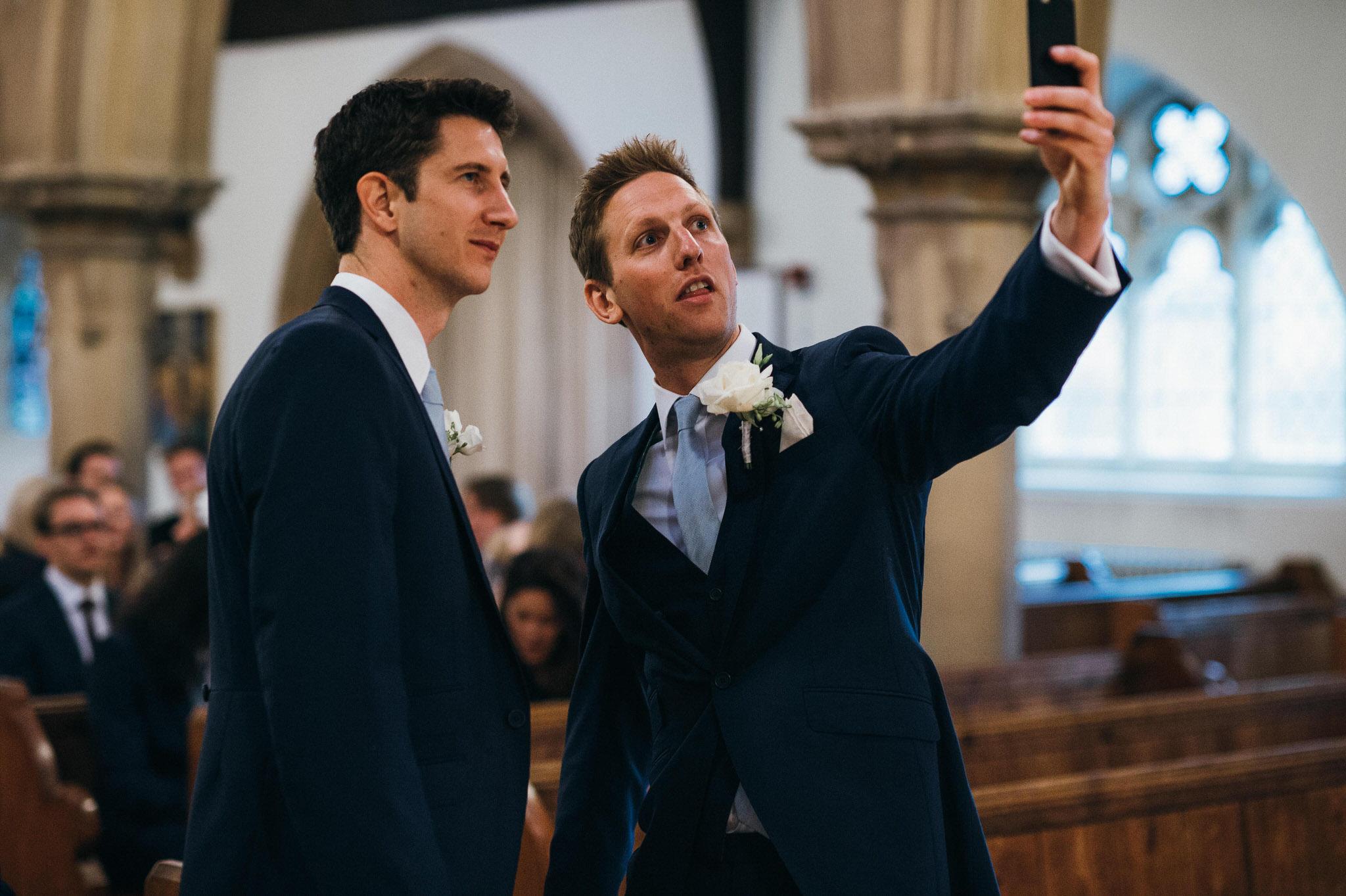 Groom takes selfie in church