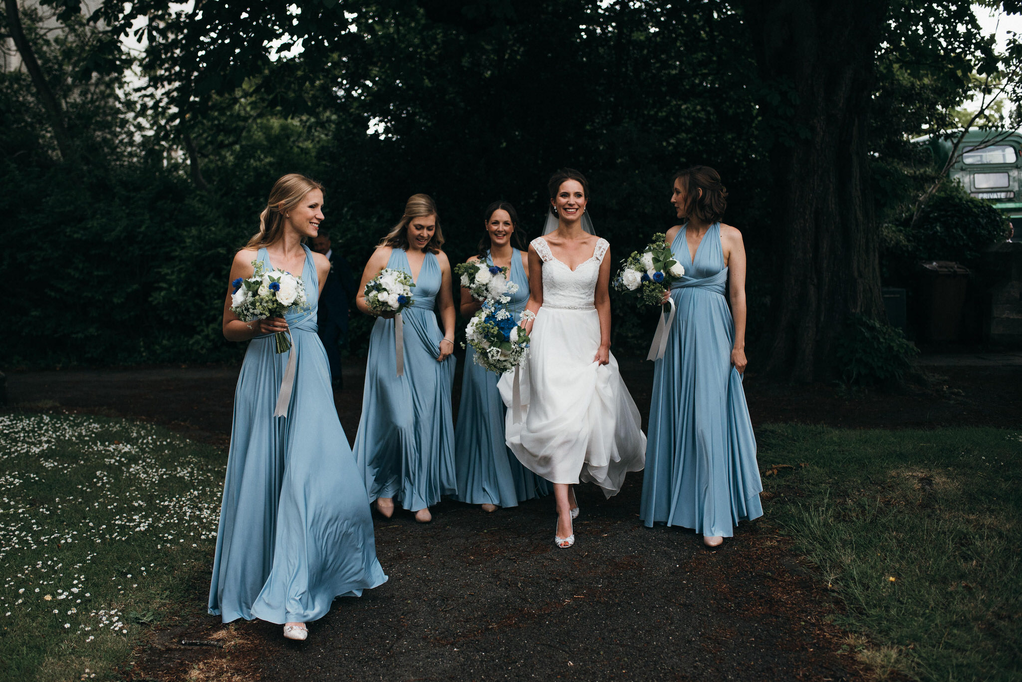 Bridal party walk to church