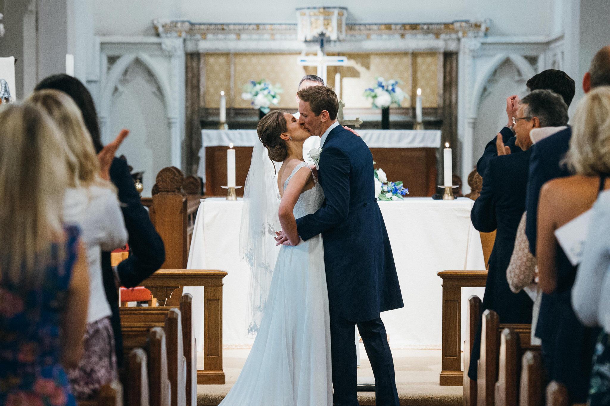 Church wedding first kiss