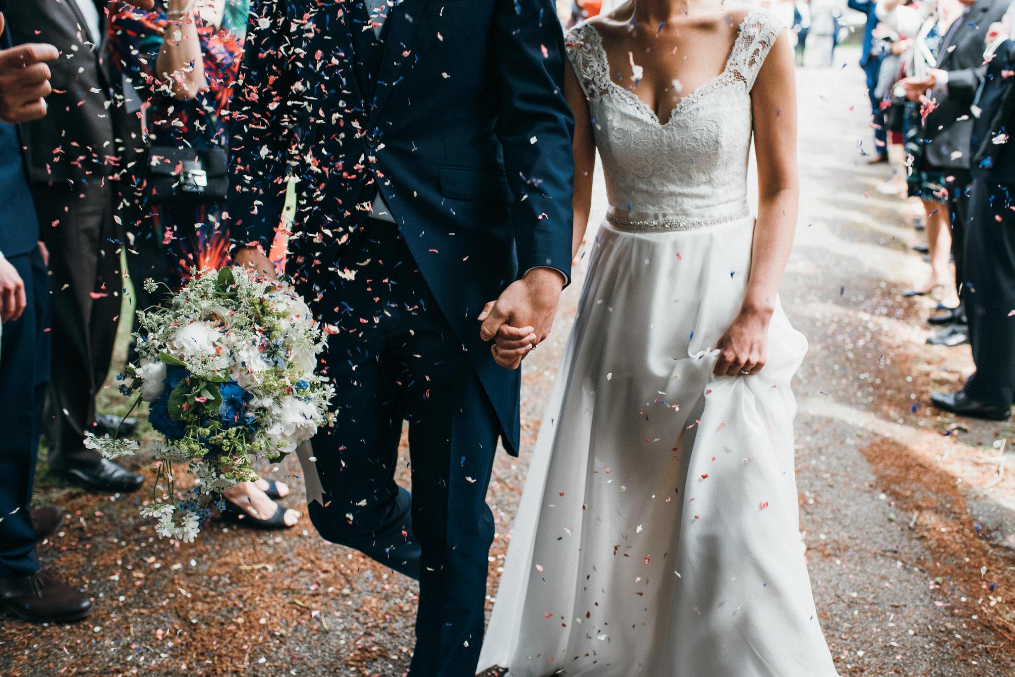 Confetti on bride and groom
