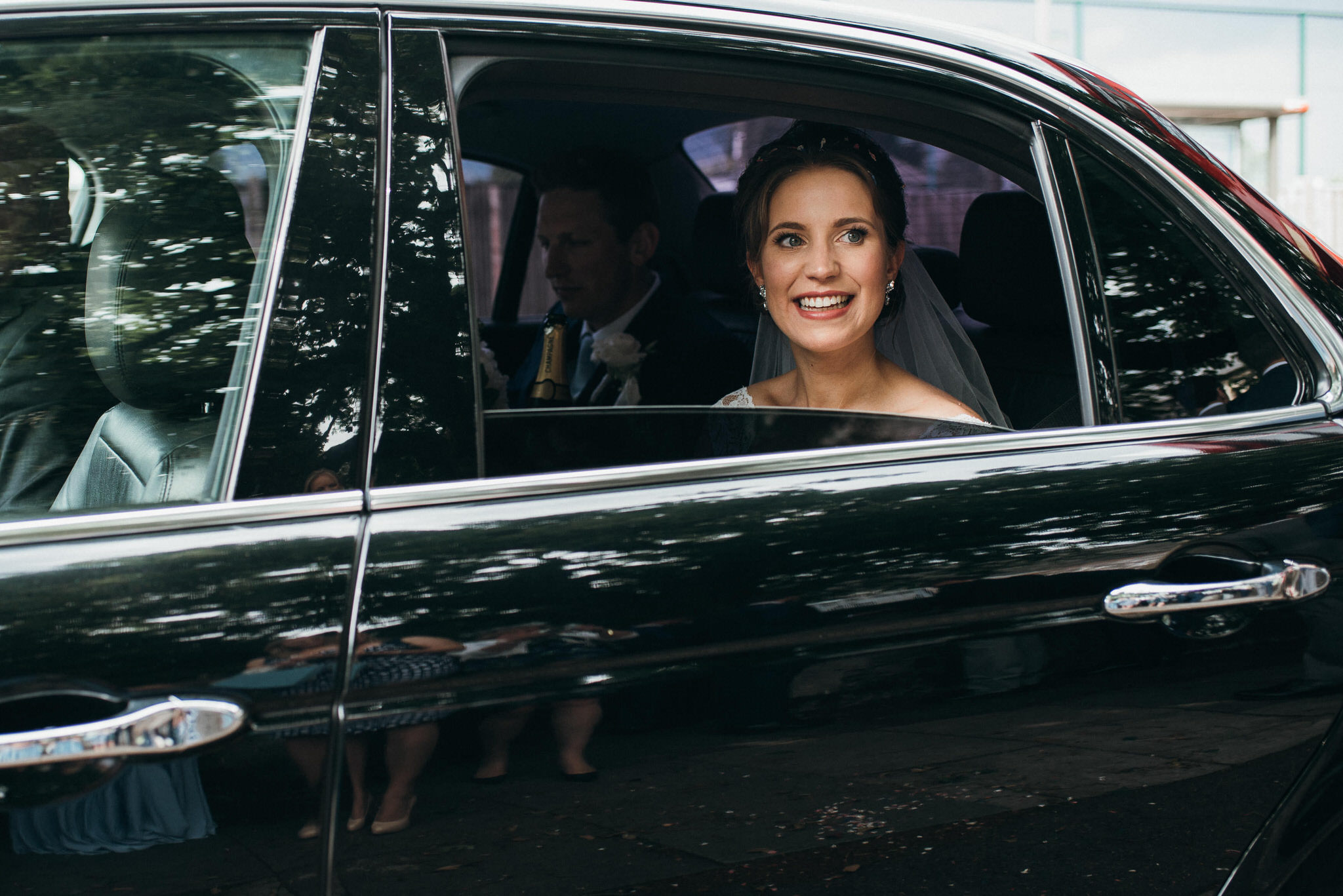 Newlyweds leave in car