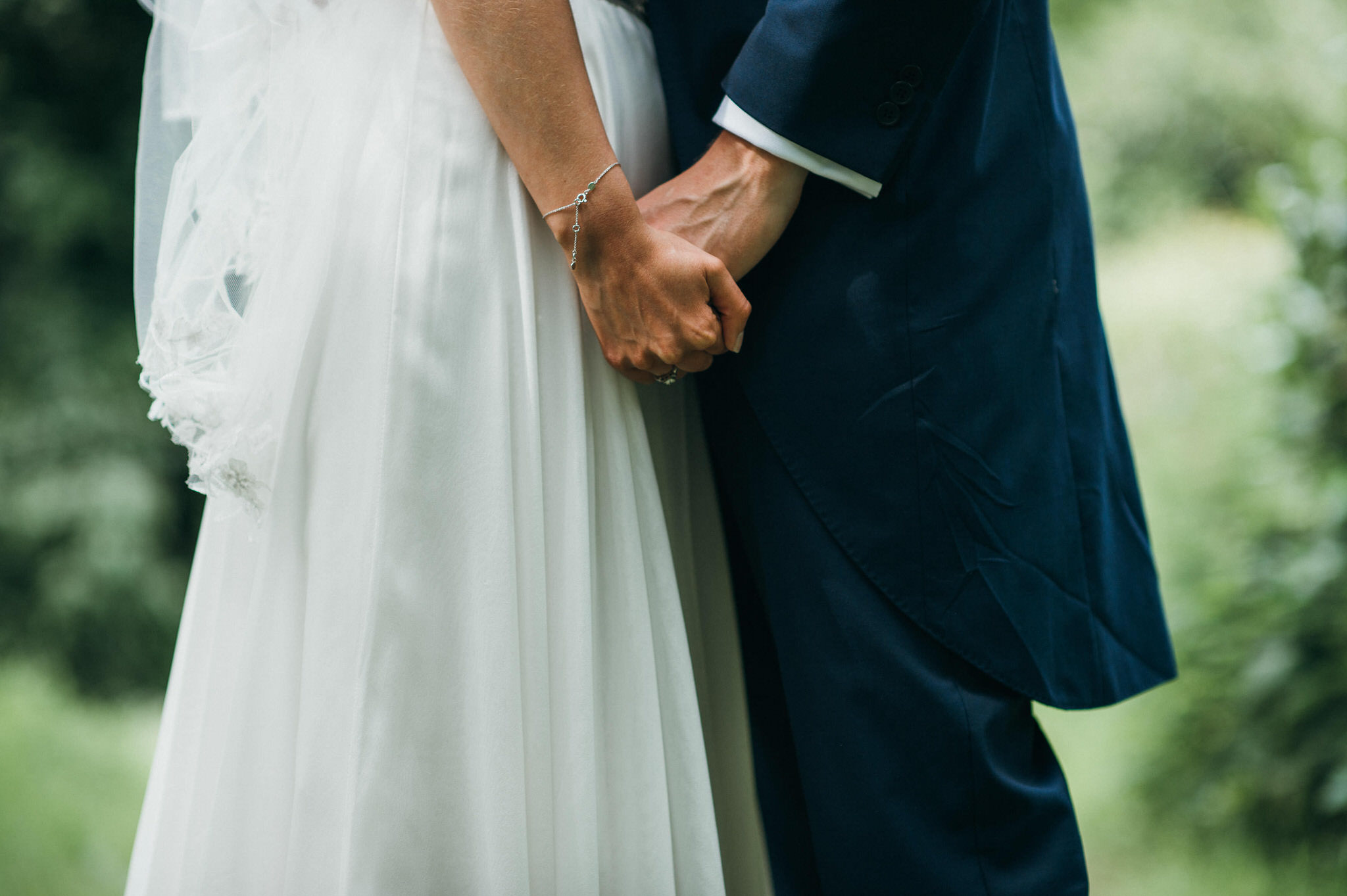 Bride and groom hand holding