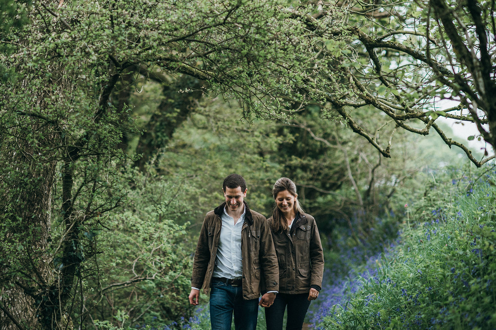 Engaged couple walking in the woods