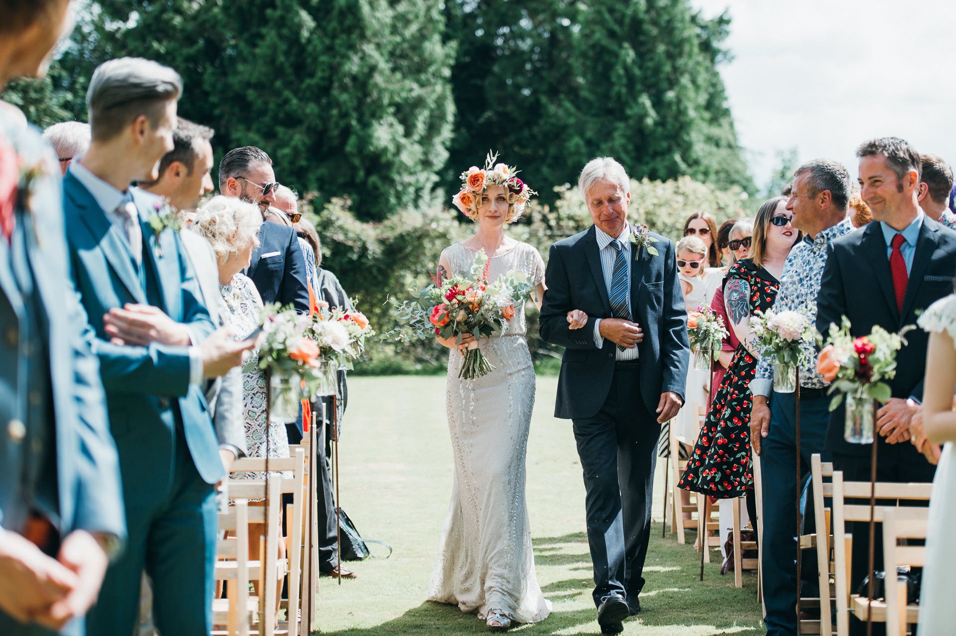 Bride and father walk down aisle Pennard house wedding