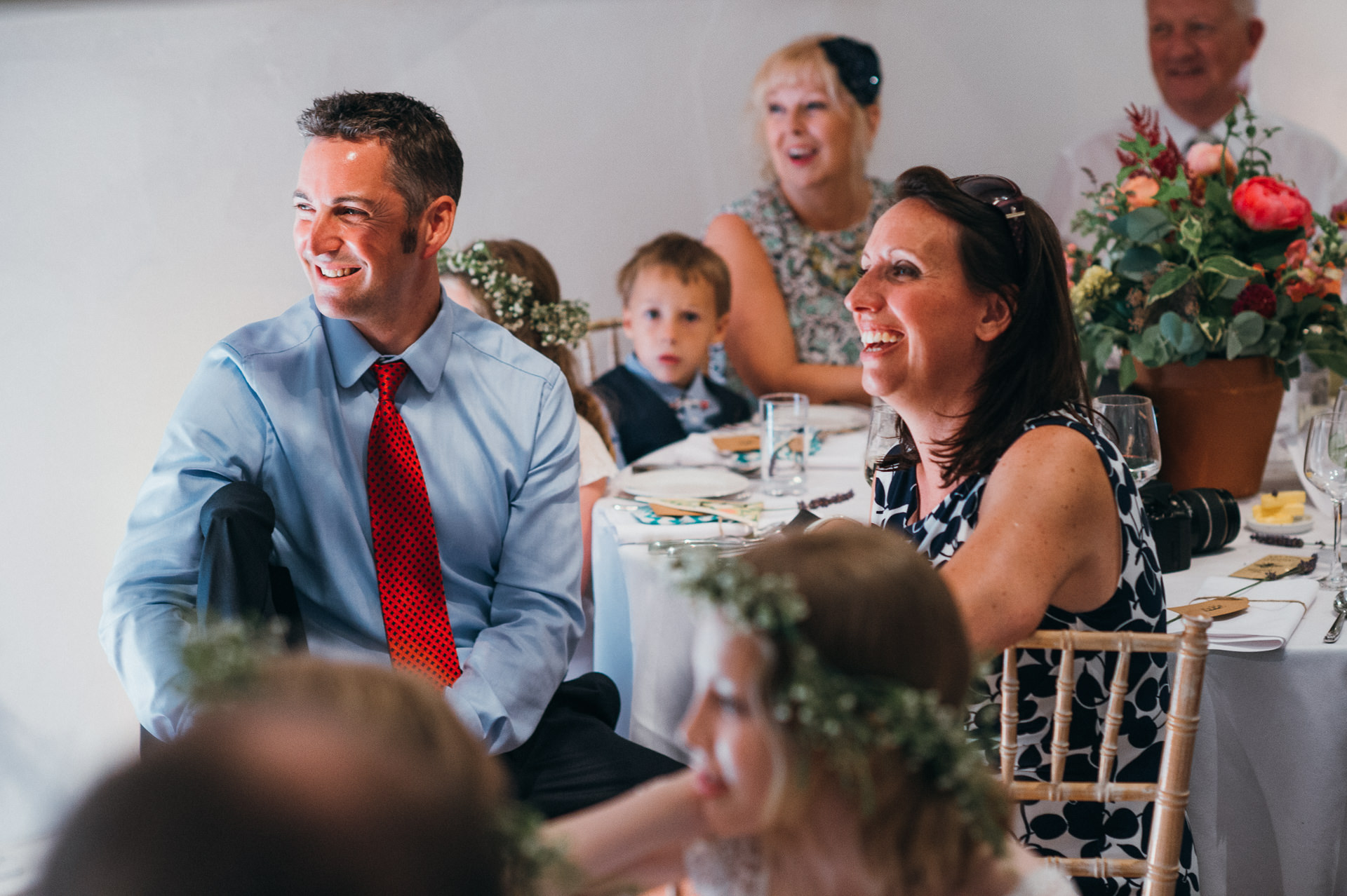 Guests listen to speeches at Pennard house wedding