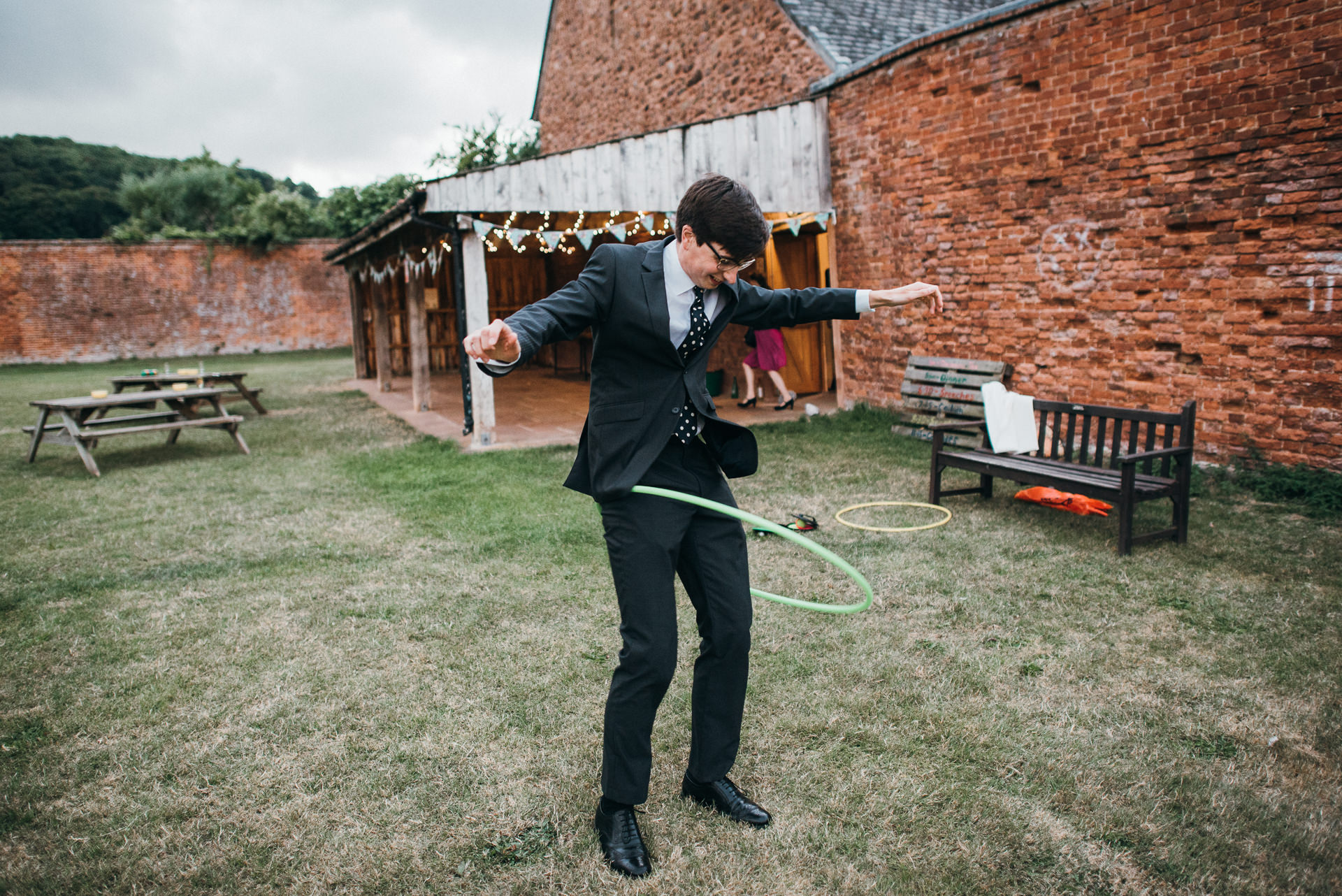 Hula hooping at Dunster Tithe Barn wedding