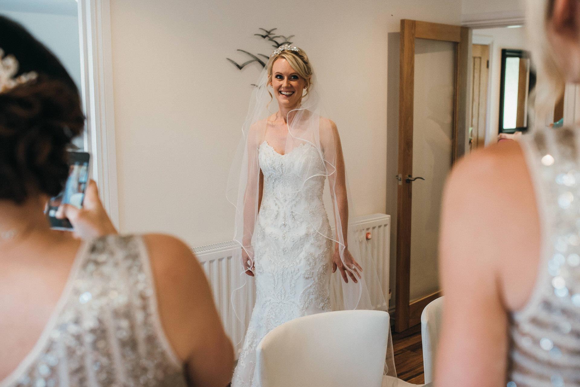 bride looking at bridesmaids