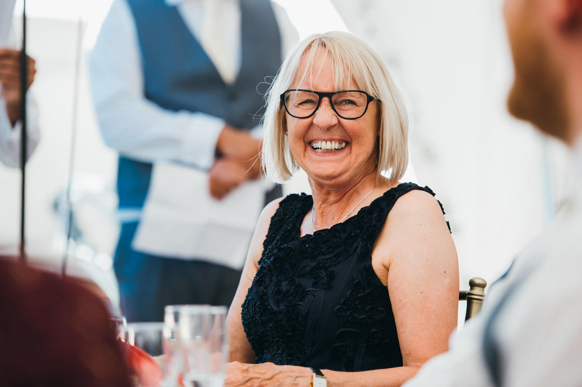 woman laughing at wedding reception