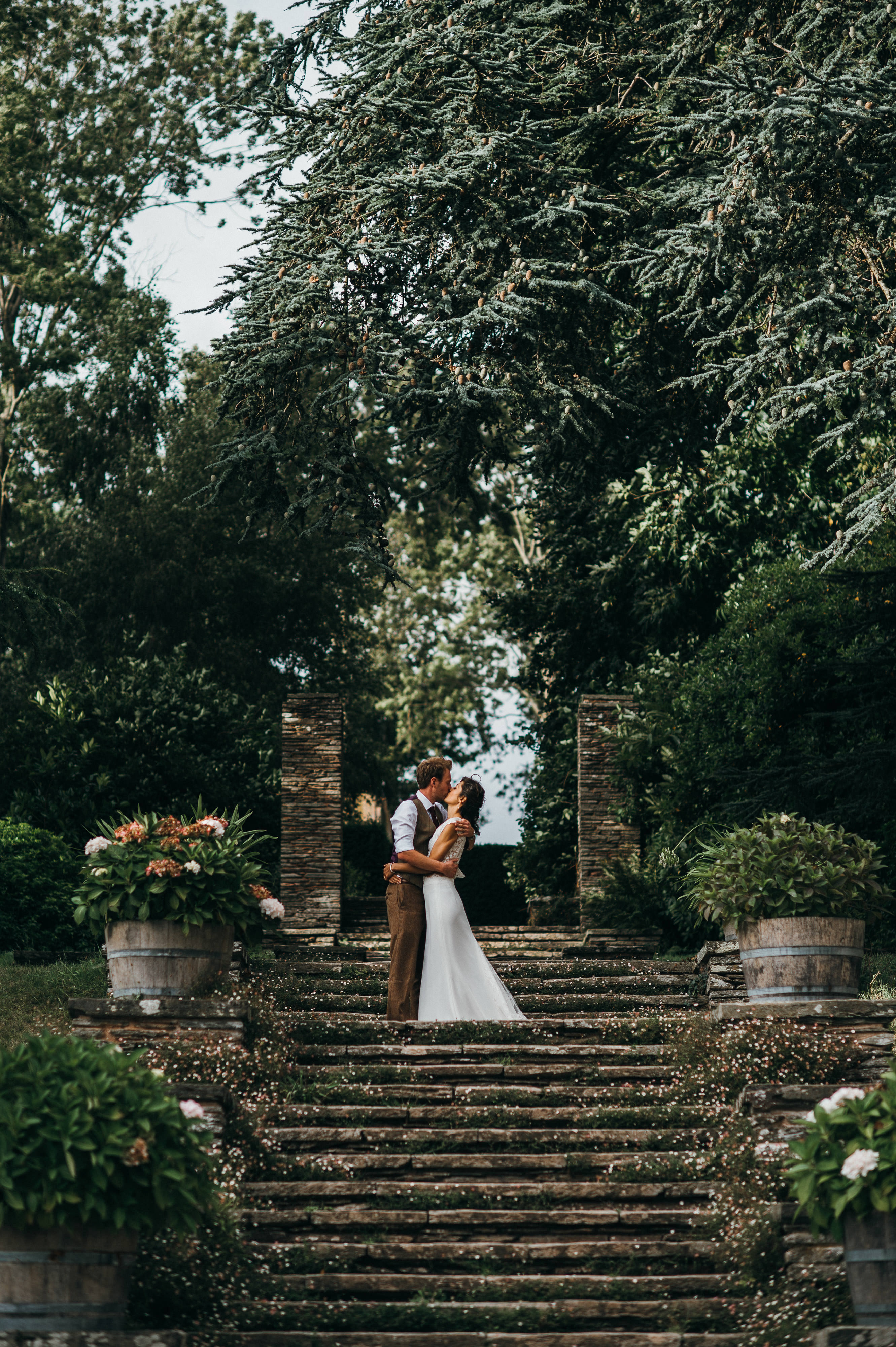 Bride and Groom kiss on steps at Hestercombe Gardens