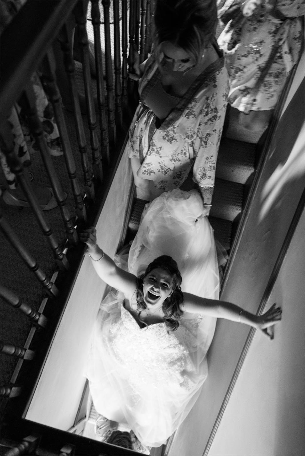 Bride laughing on stairs