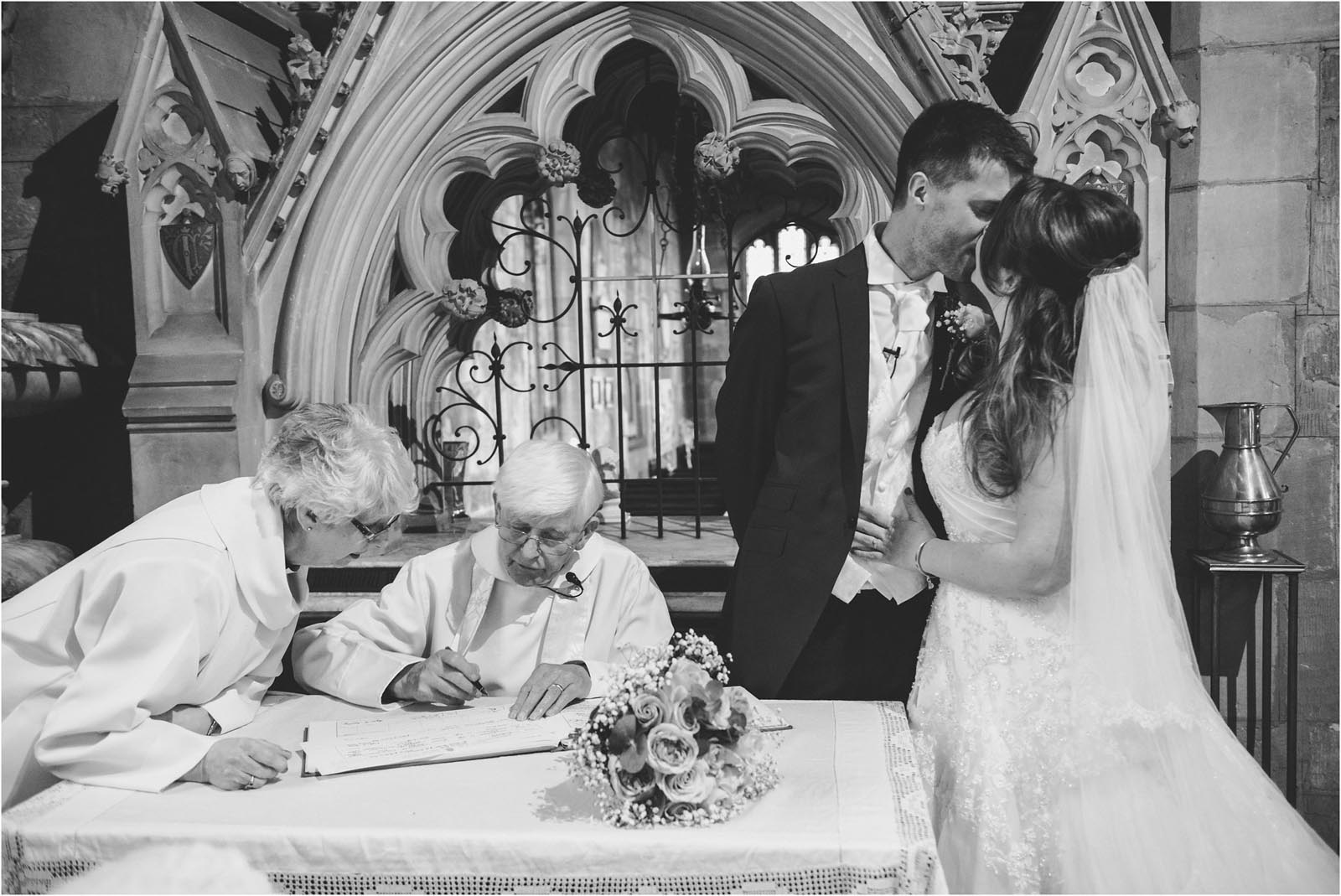 couple kiss during register signing