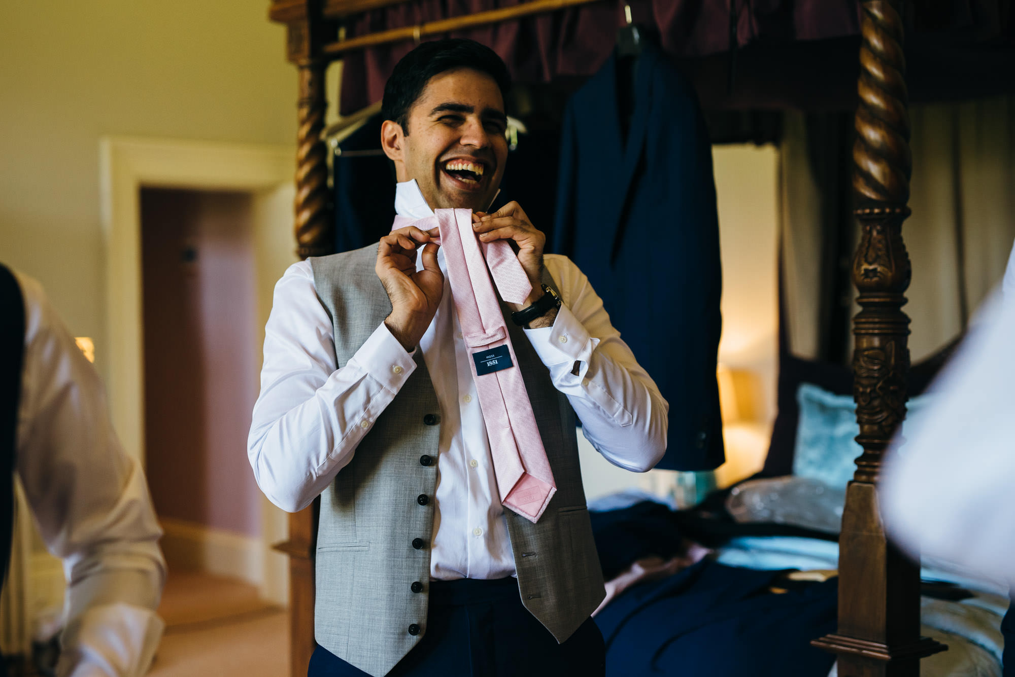 Groom changing for wedding