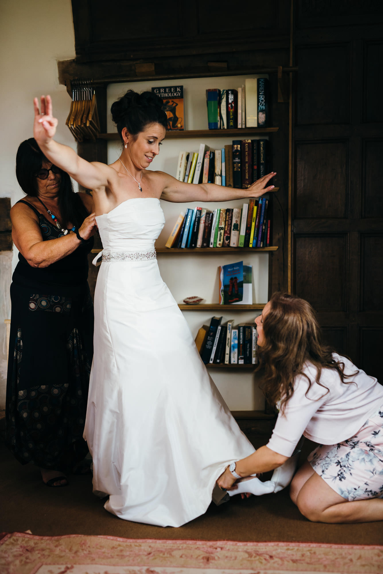 Bride puts shoes on