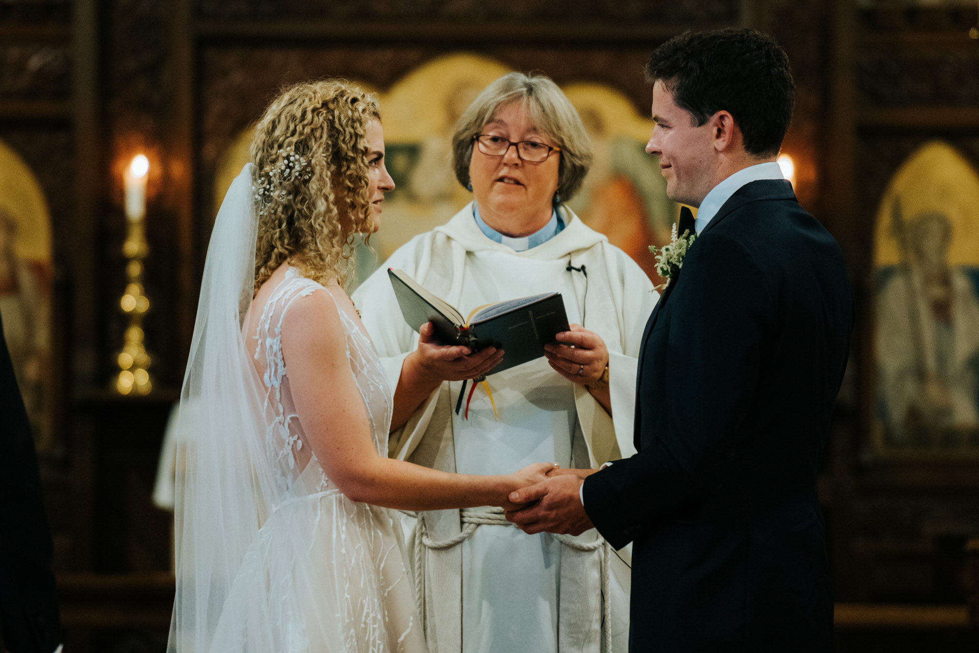Bride and Groom exchange vows in church wedding ceremony