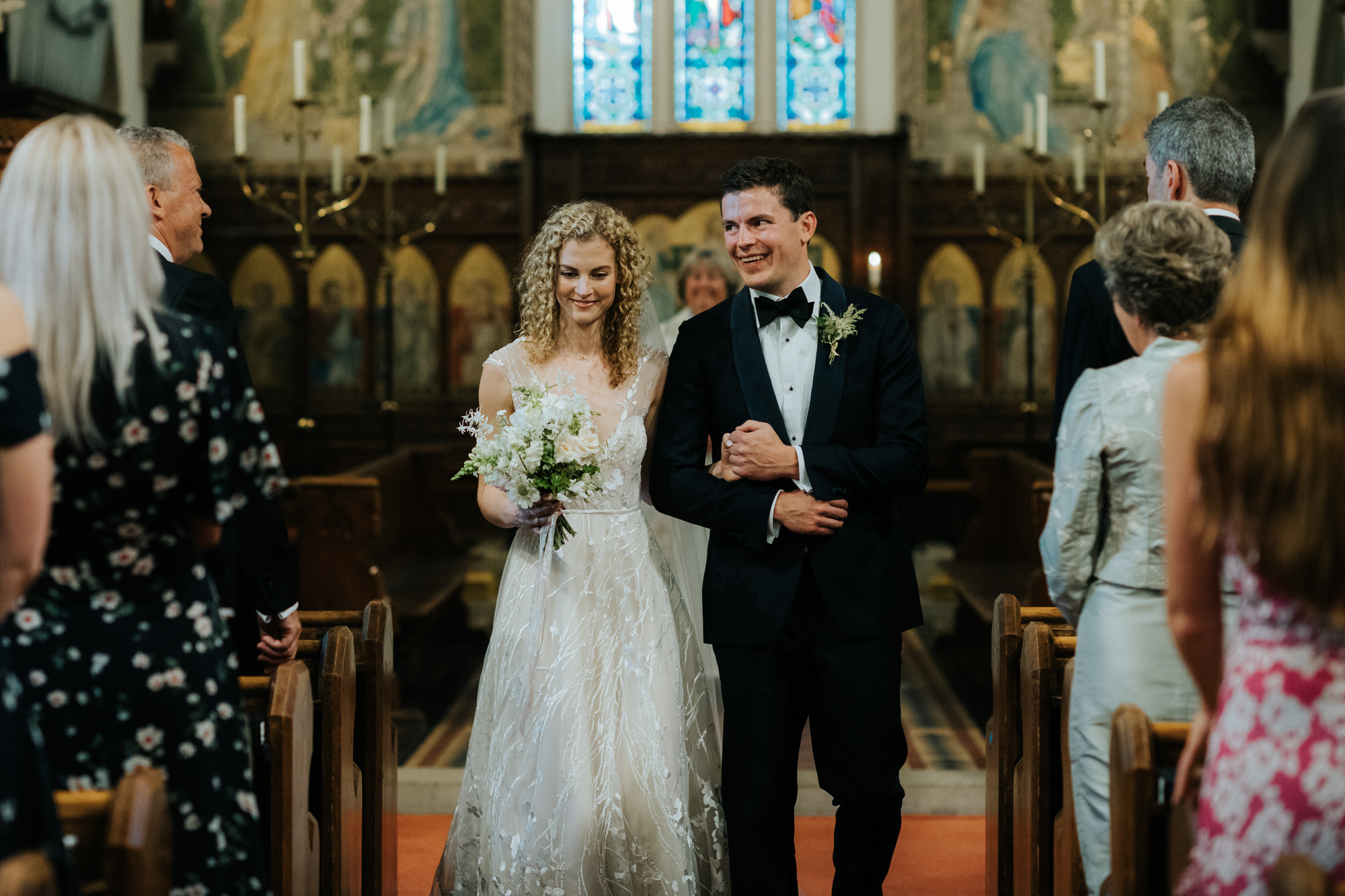 Bride and Groom walk down aisle in church after getting married