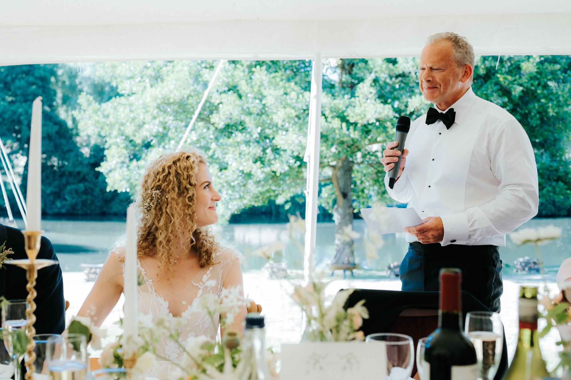 Father of bride looks at daughter during his speech