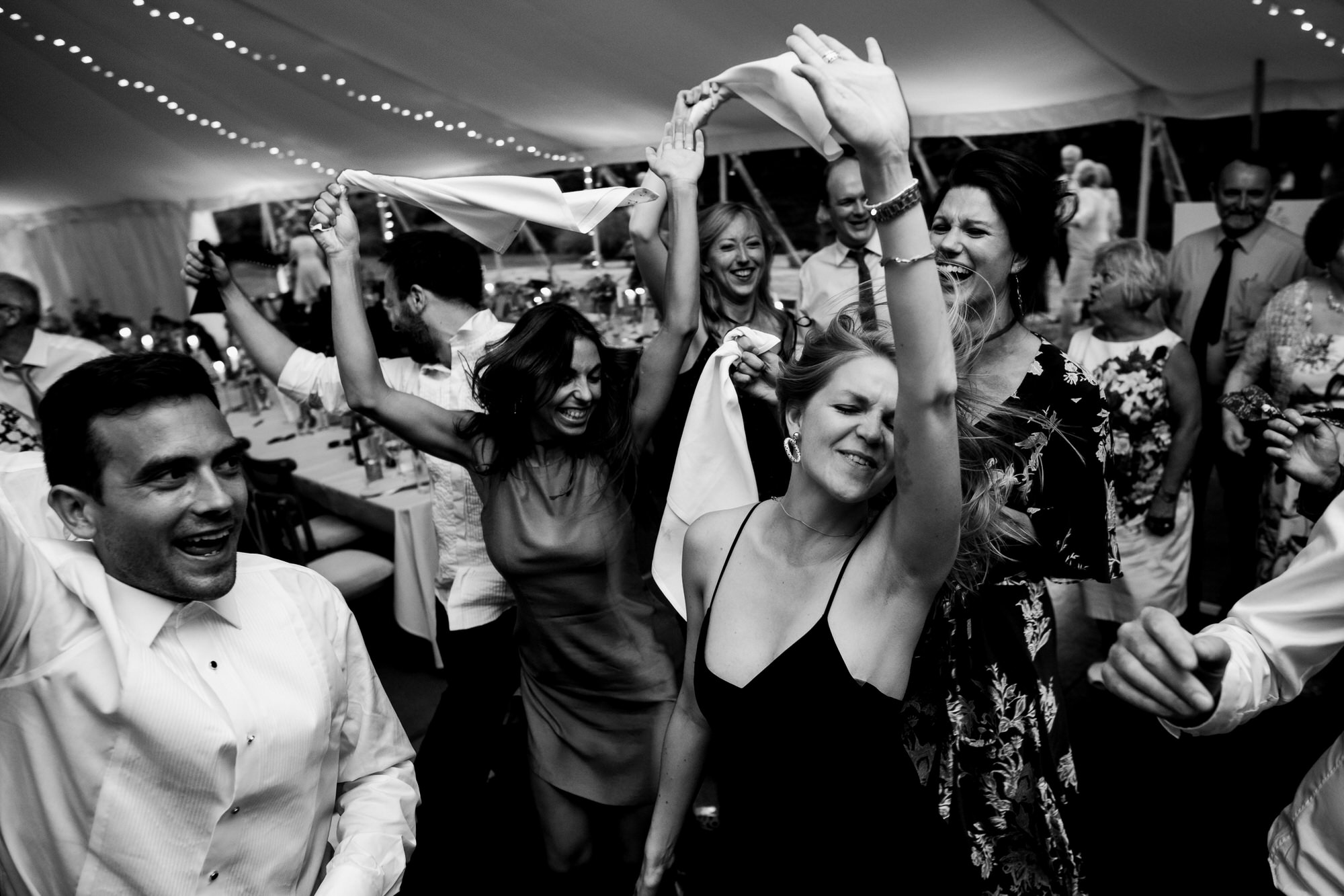 Party goers raise arms on the dance floor