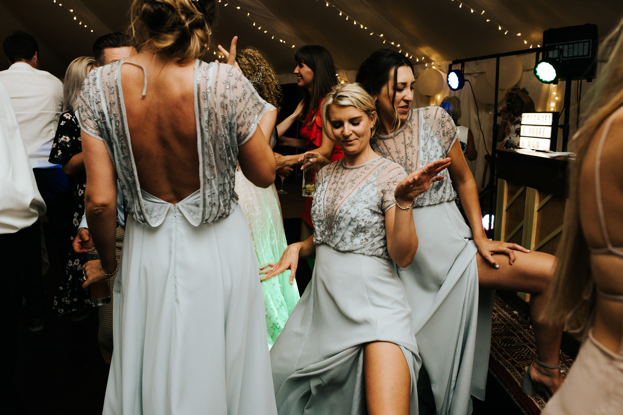 Guests dancing at wedding in marquee