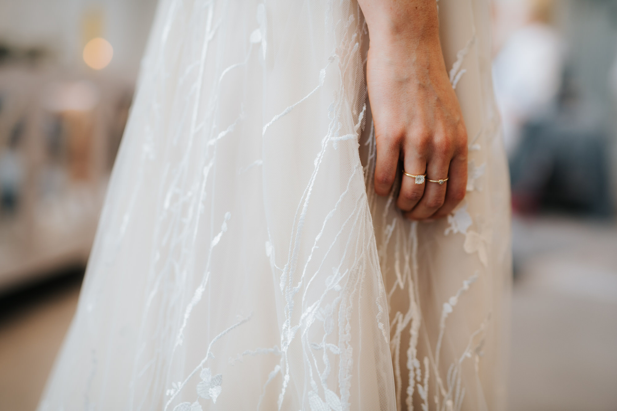 Close up of Bride's hand on her dress