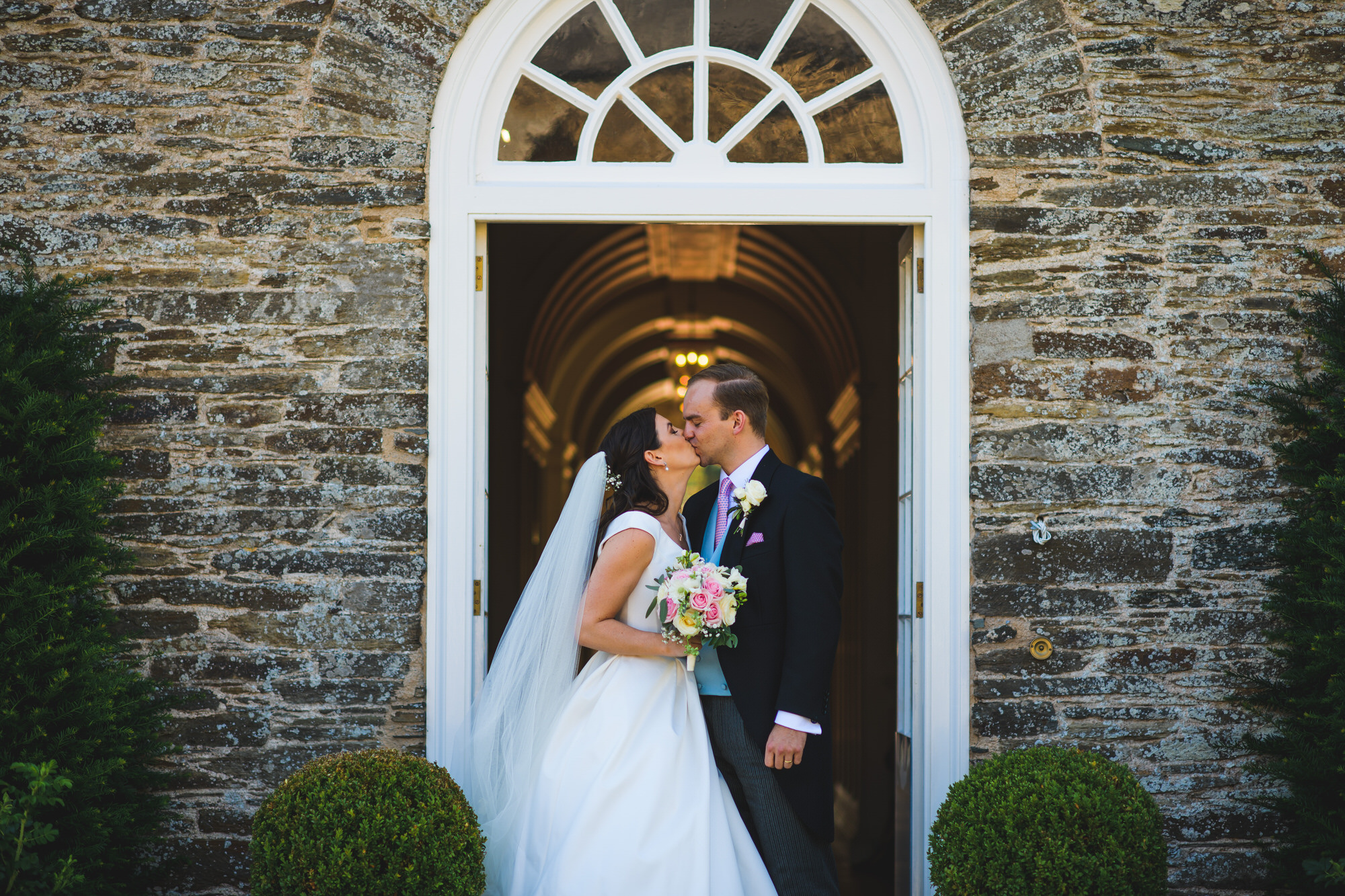 Bride and Groom laughing at Shilstone house