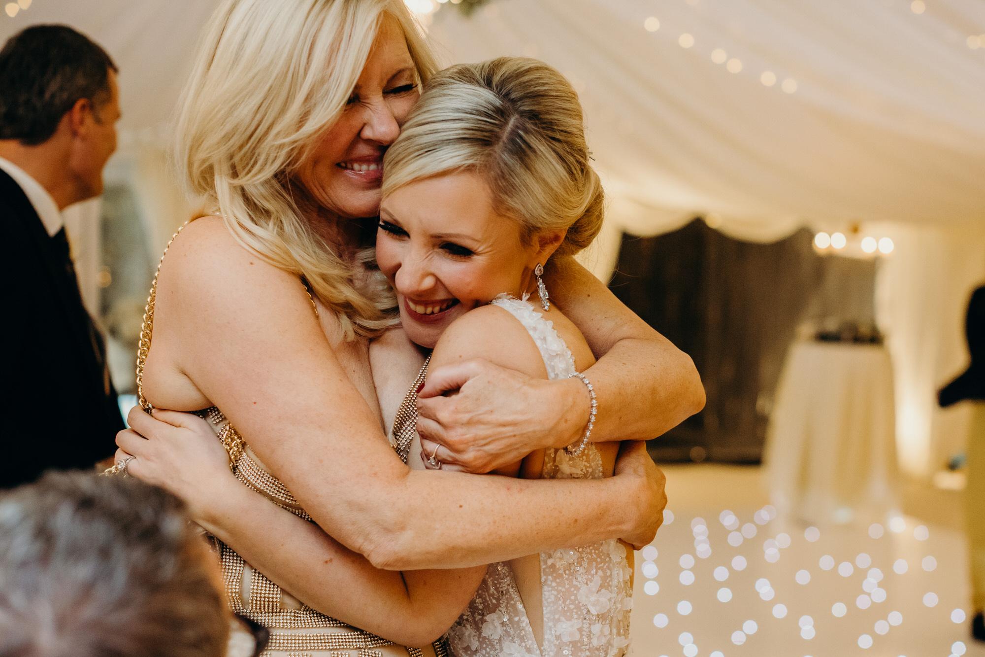 bride hugs mum during wedding