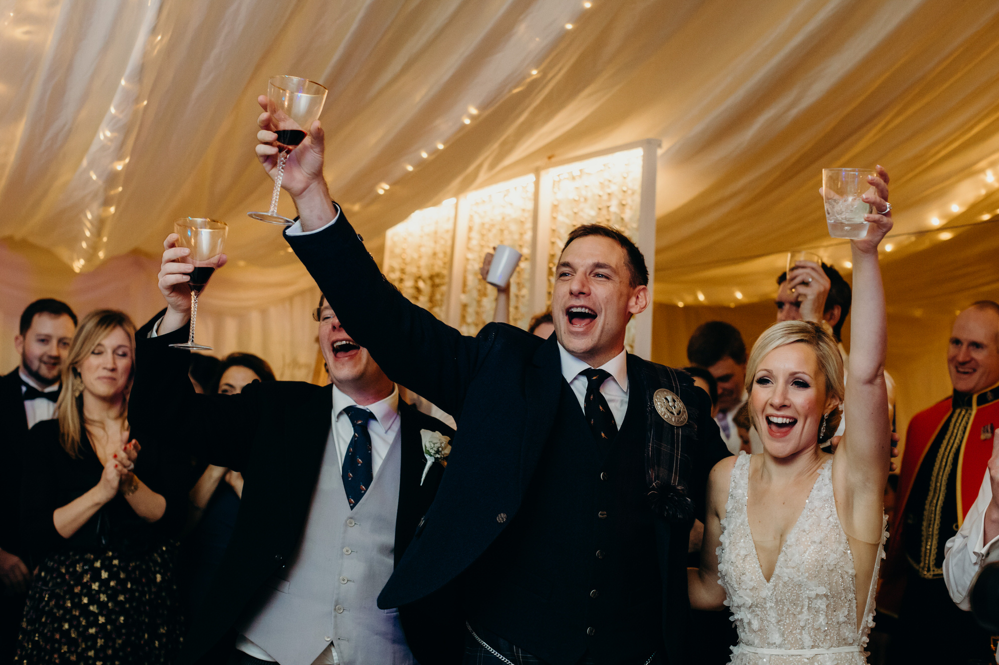 Cheers from wedding guests