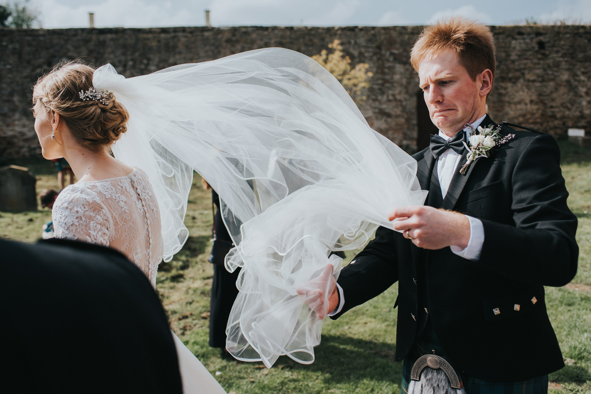 Groom struggles with veil