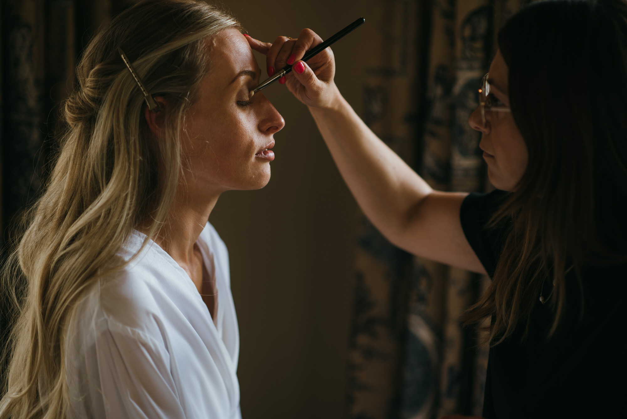 Bride having makeup