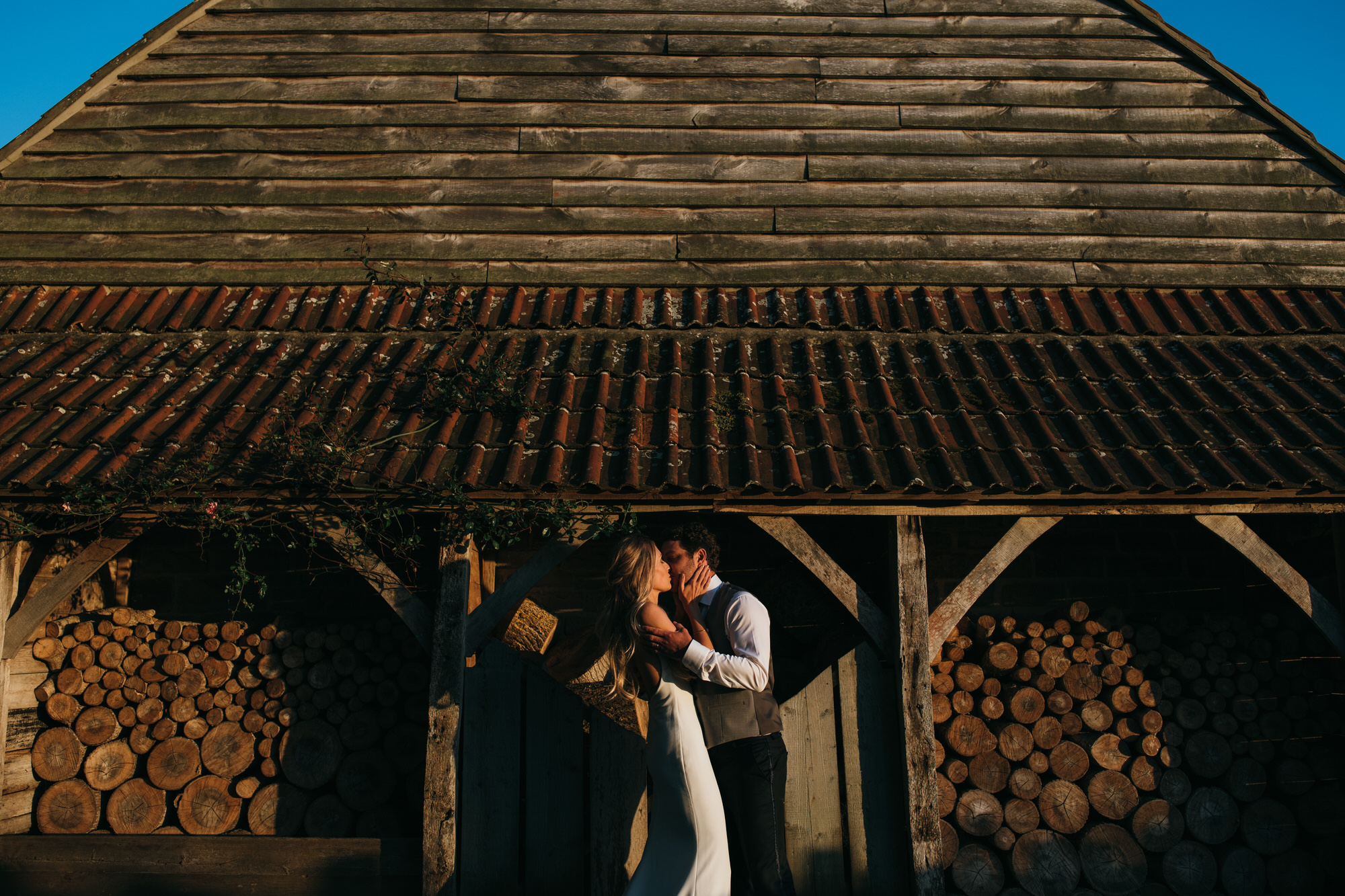 Newlyweds by the Almonry Barn