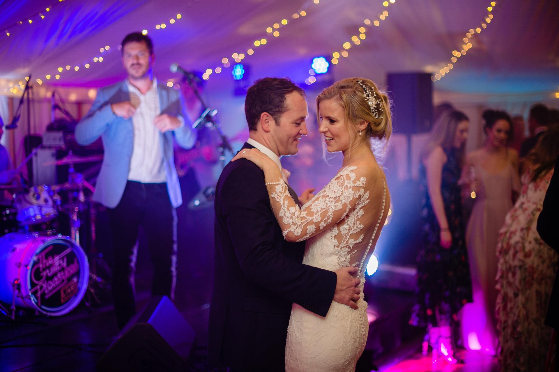 Bride and groom dancing Bignor Park
