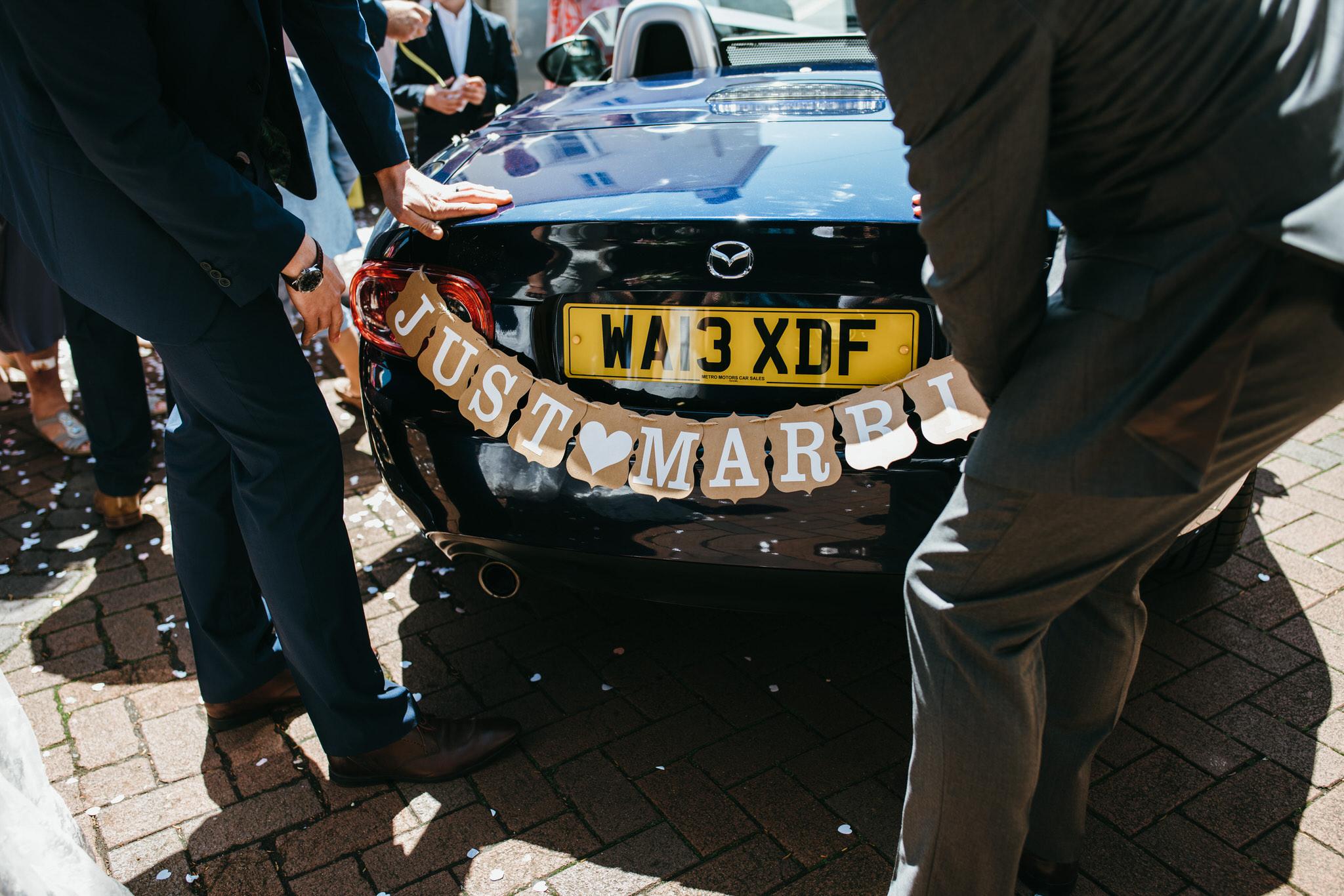 Wedding car with bunting